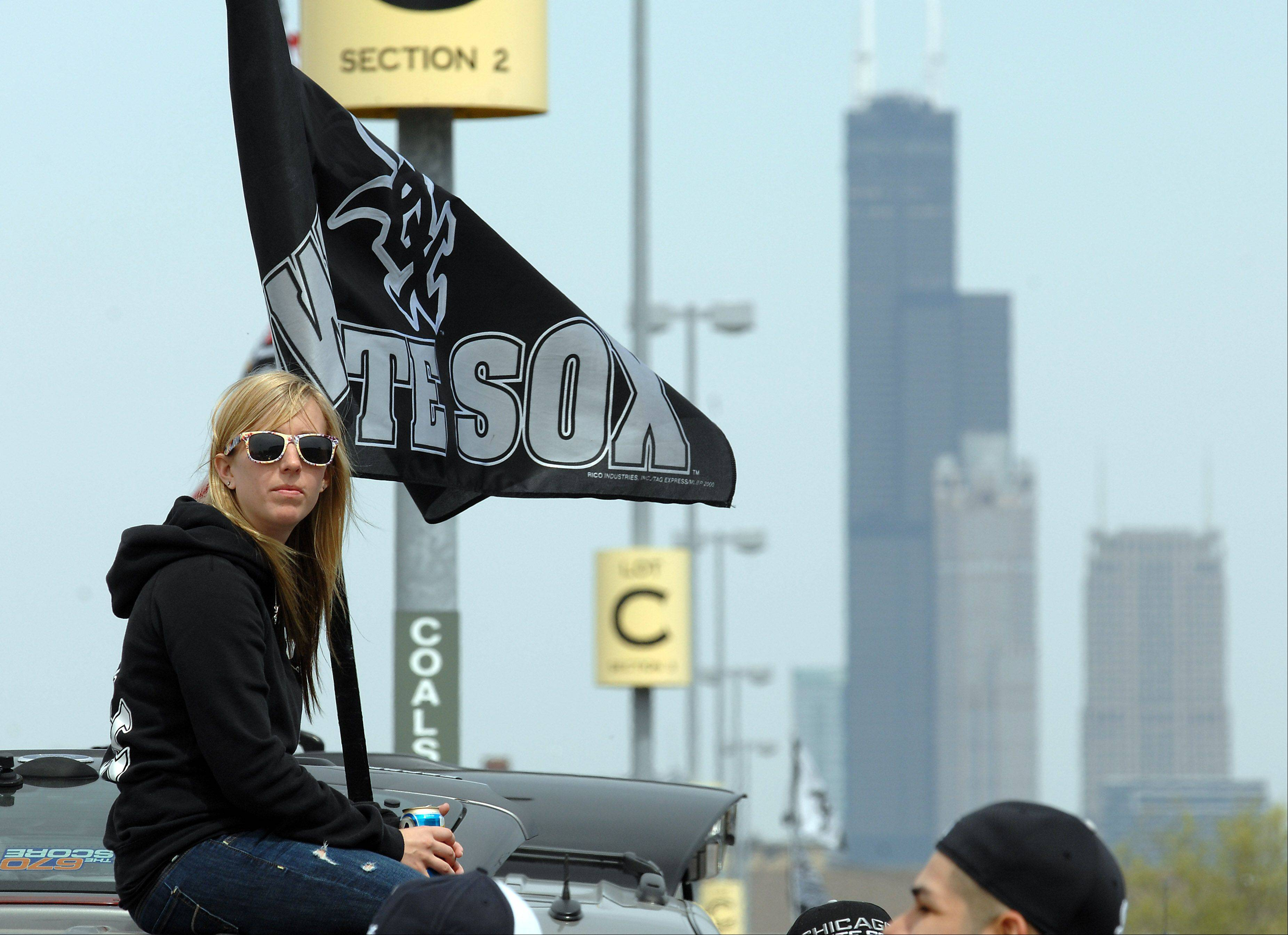 White Sox fan Magan Little of Lockport tailgates in the parking lot.