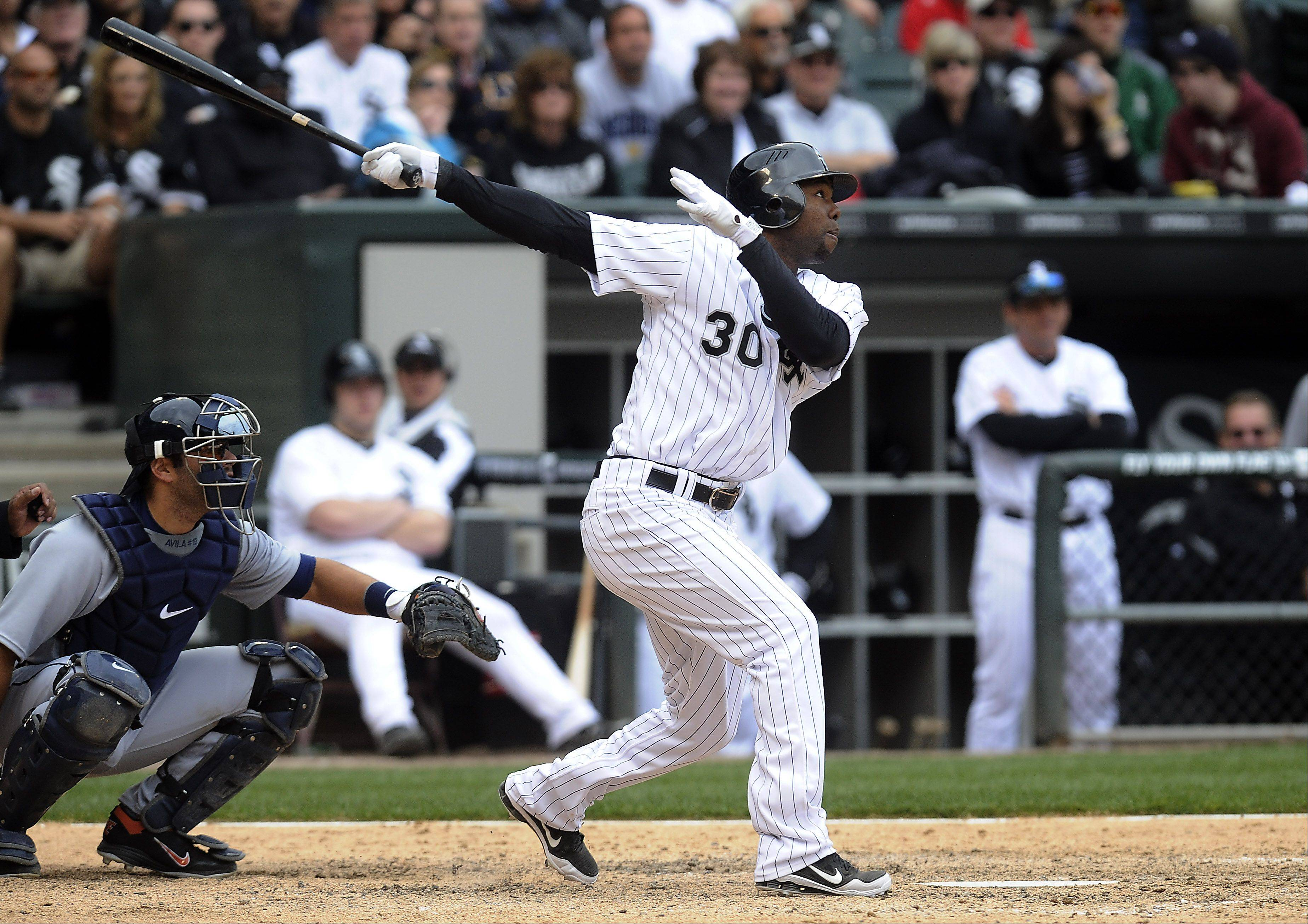 White Sox Alejandro De Aza hits a triple in the eighth inning.