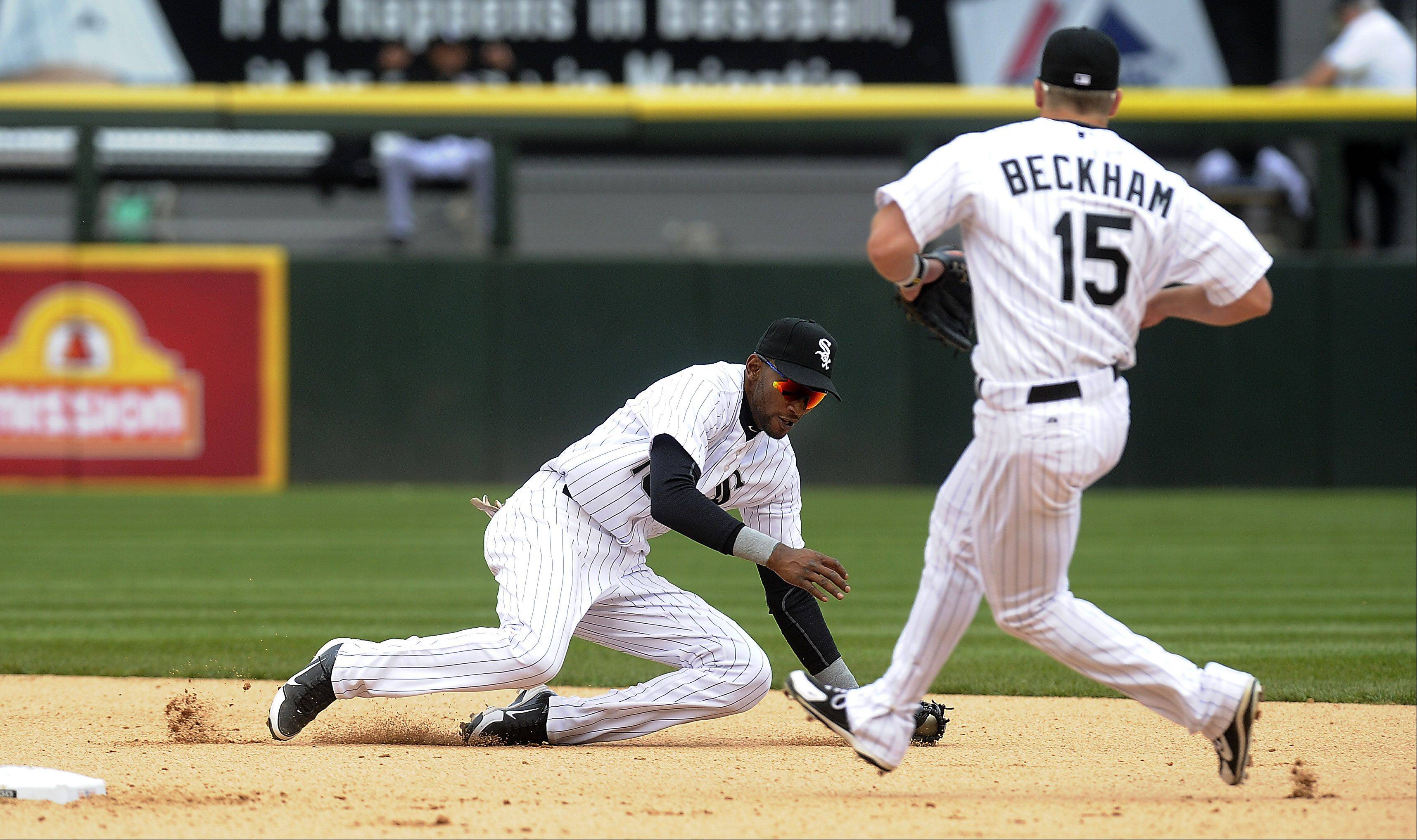 White Sox's Alexei Ramirez stops a ball hit by the Tiger's Miguel Cabrera in the eighth inning .