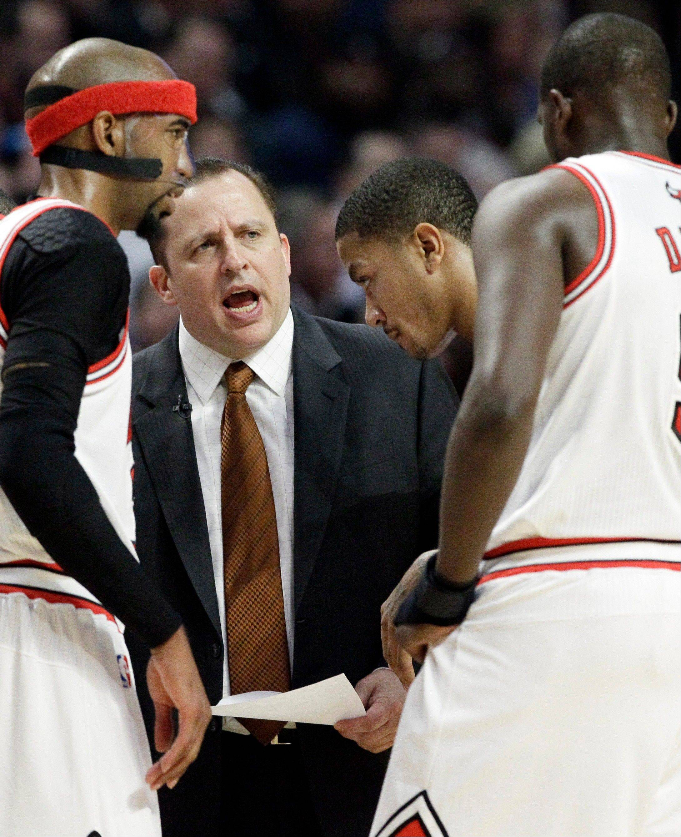 Coach Tom Thibodeau talks strategy with Rip Hamilton, left, Derrick Rose and Luol Deng, right, during Thursday's game against the Heat at the United Center. The Bulls won 96-86 in overtime.