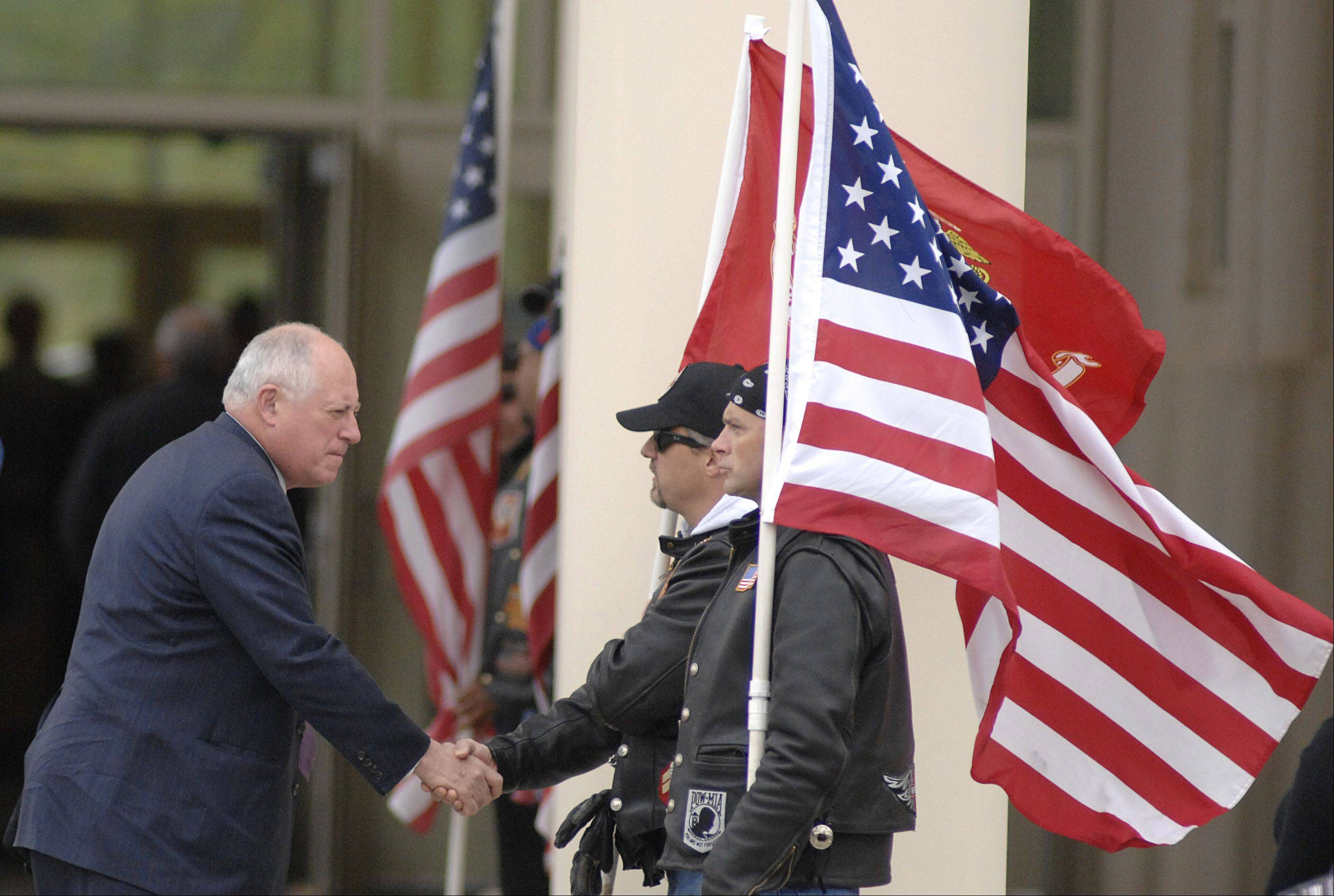 Illinois Gov. Pat Quinn greets members of the Patriot Guard standing outside Life Changers International Church for the funeral of Cpl. Alex Martinez in Hoffman Estates. The Marine from Elgin was killed during combat operations in Afghanistan.