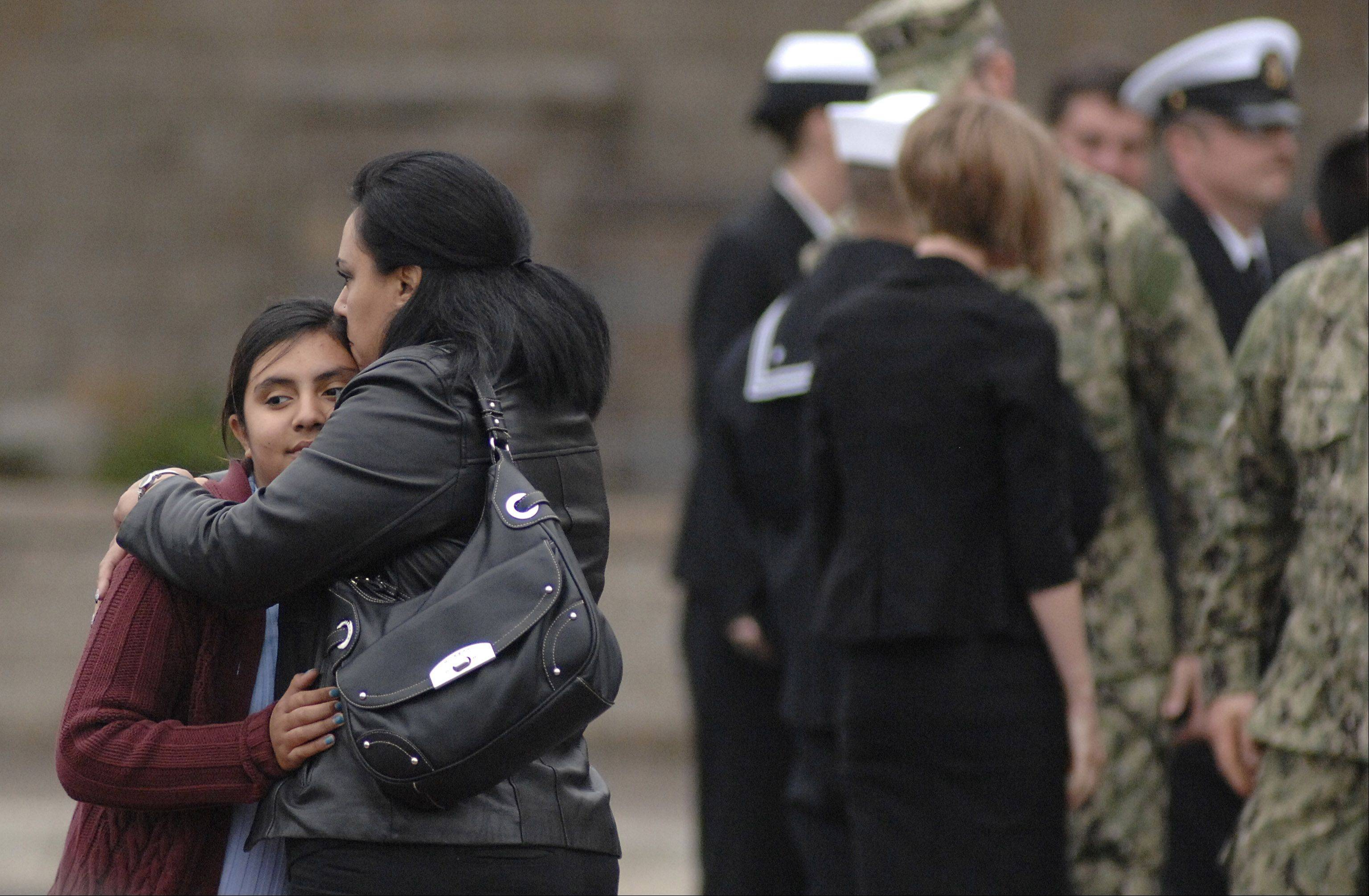 Family and friends comfort each other after the funeral for Cpl. Alex Martinez at Life Changers International Church in Hoffman Estates on Saturday.
