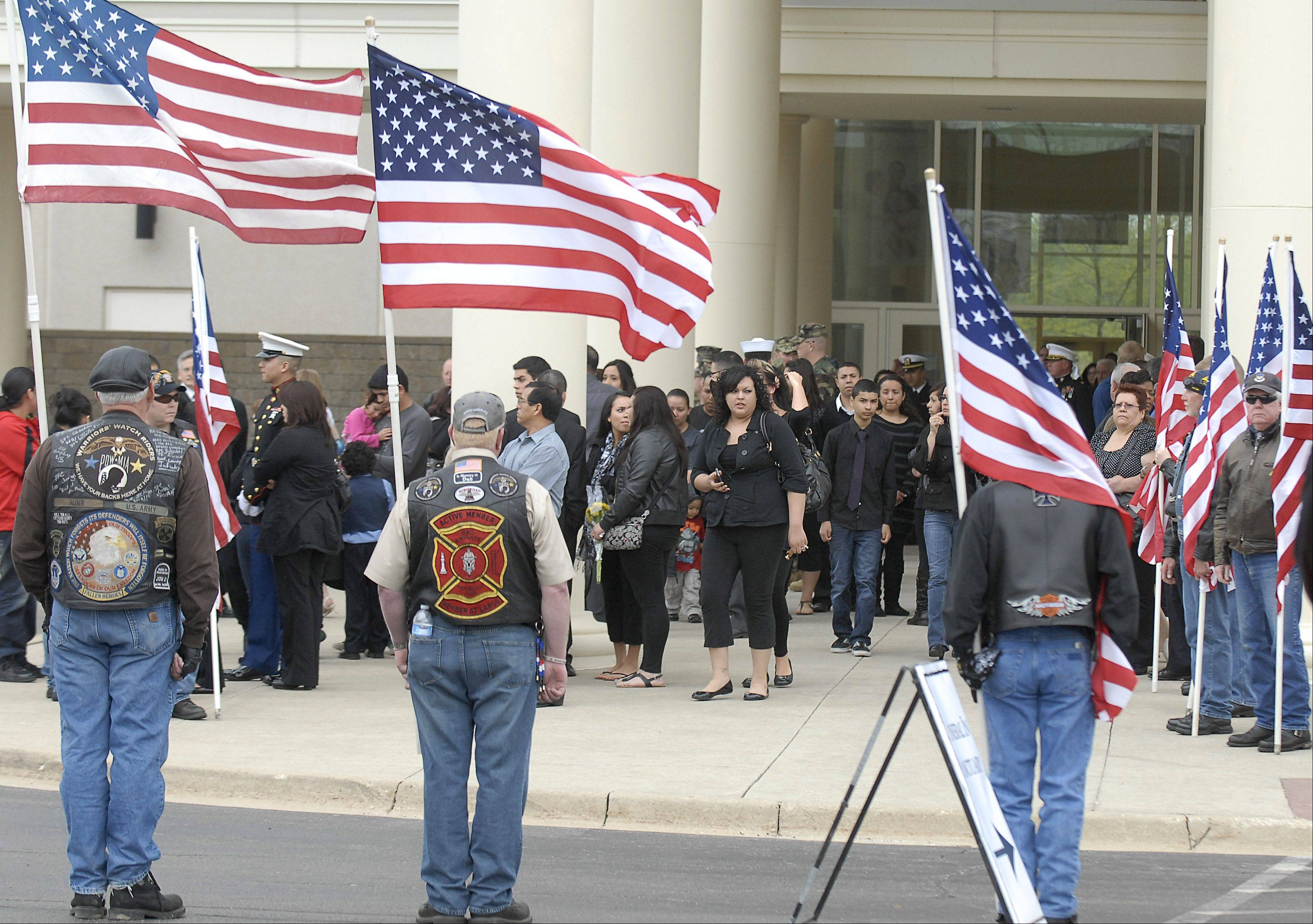 Family and friends gather outside Life Changers International Church after the funeral of Cpl. Alex Martinez in Hoffman Estates on Saturday. The Marine from Elgin was killed during combat operations in Afghanistan.