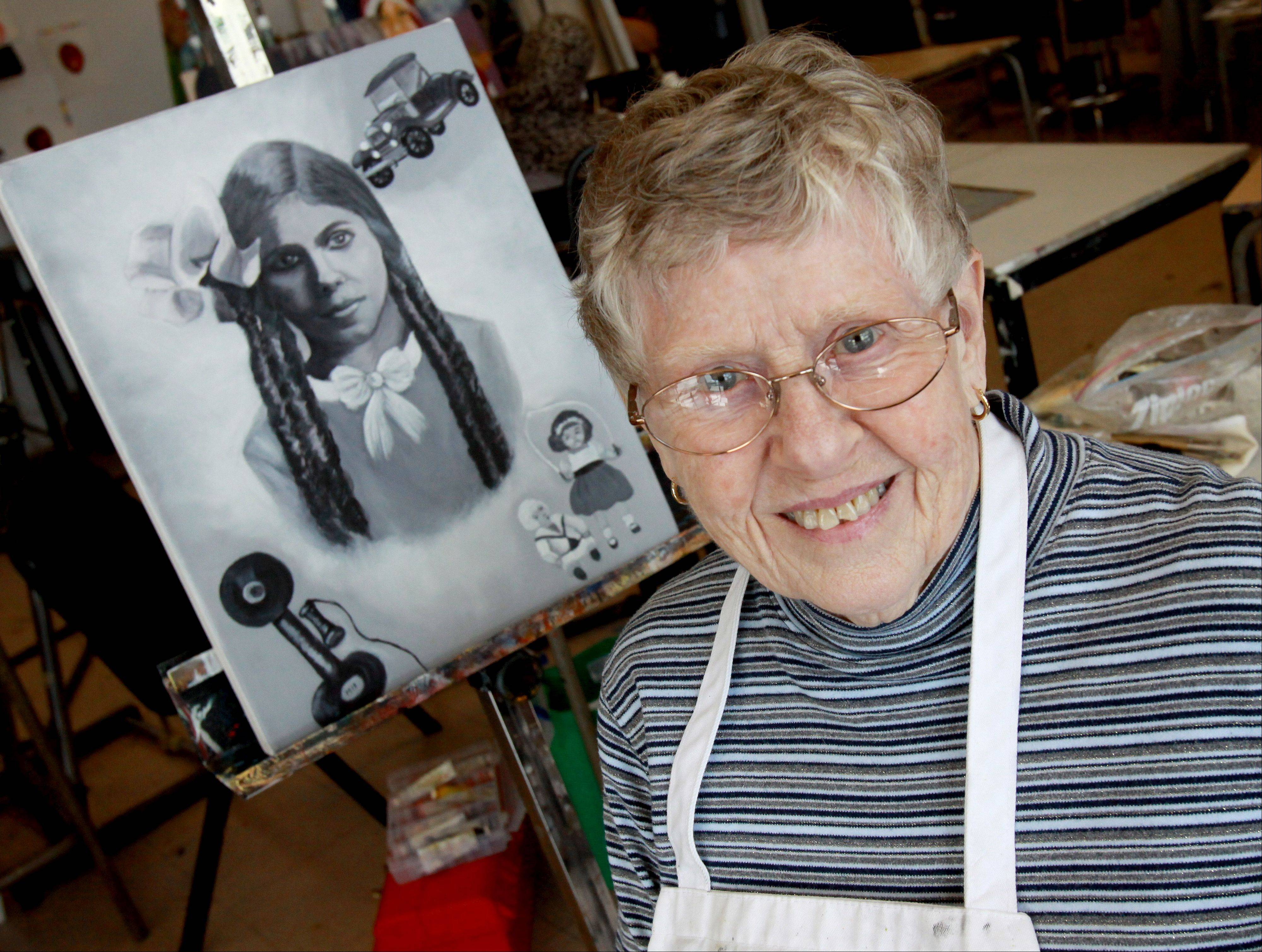 College of DuPage painting student Leah Tait of Addison shows off a portrait she did of what her mother-in-law looked like around 1913.