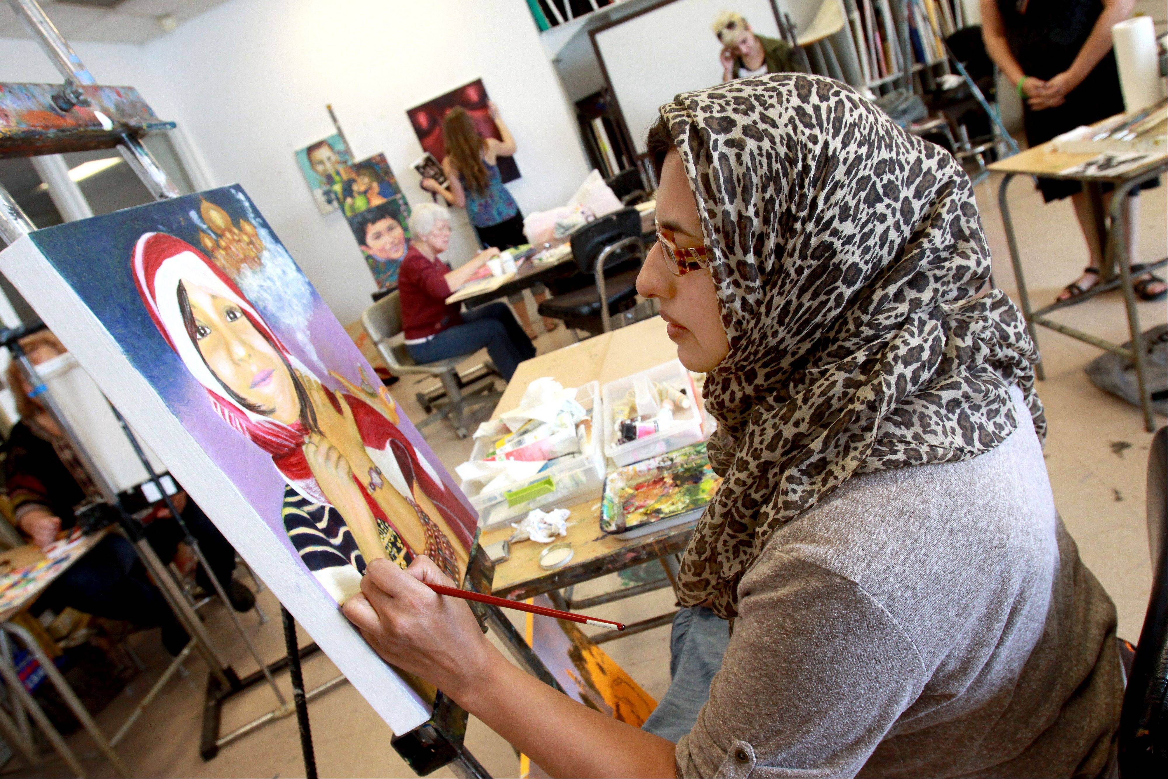 Shahin Safdar of Lombard paints a picture of her niece to show diversity and different cultures.