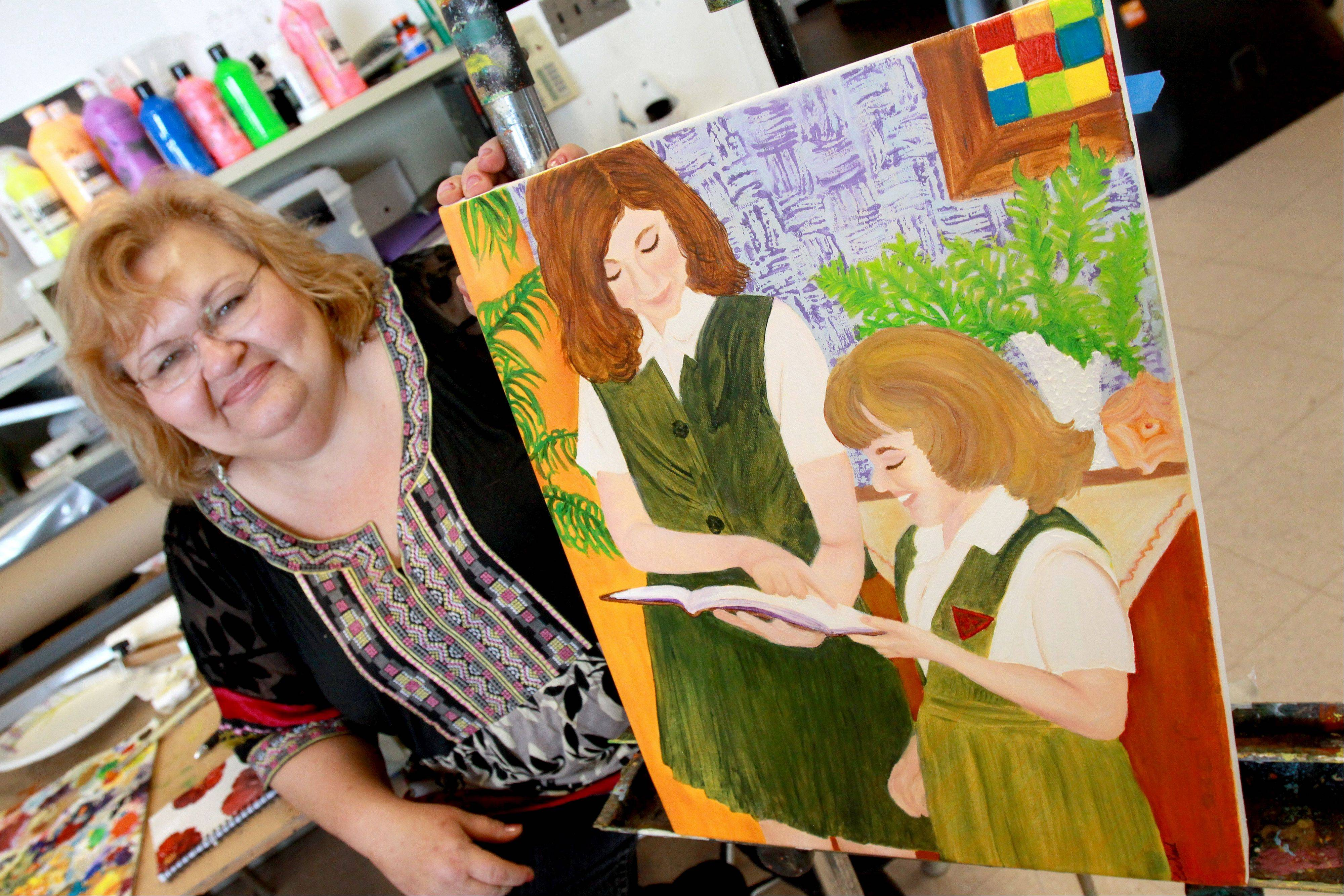 Eve Reed of Lombard, who attended Maternity B.V.M., painted a picture of her and her sister in their school uniforms.