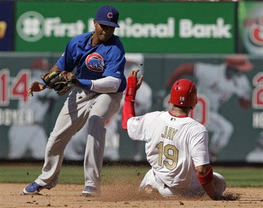 St. Louis Cardinals' Jon Jay steals second asStarlin Castro applies the late tag in the fifth inning Saturday in St. Louis. The Cards won 5-1.