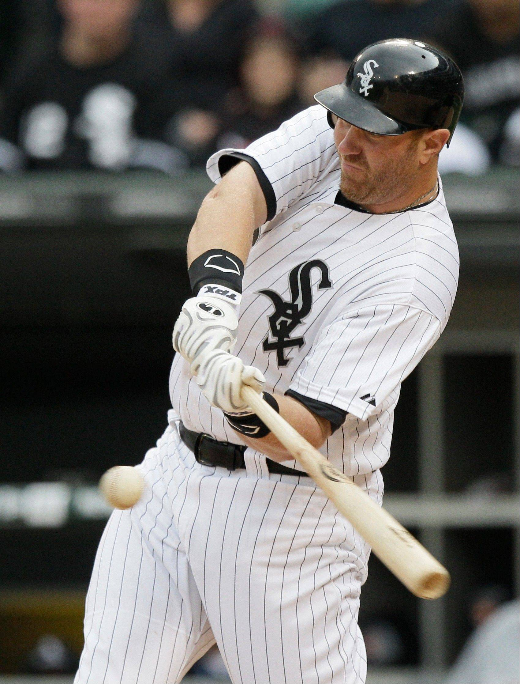 Chicago White Sox's Adam Dunn hits a one-run double against the Detroit Tigers during the sixth inning of a baseball game in Chicago, Saturday, April 14, 2012.