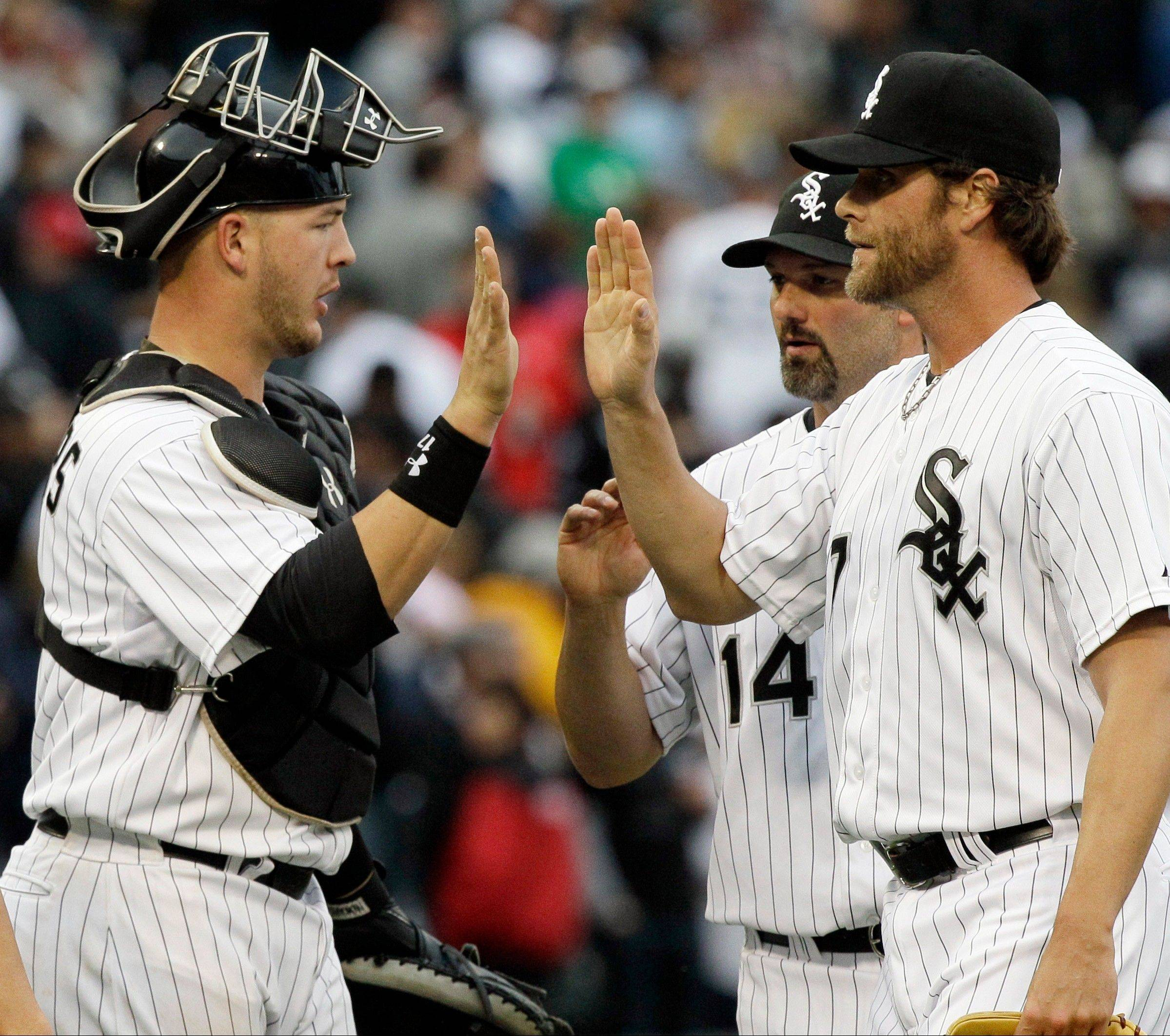 White Sox closer Matt Thornton, right, catcher Tyler Flowers and Paul Konerko celebrate after the White Sox beat the Tigers 5-1 Saturday at U.S. Cellular Field. Making a rare start, Flowers homered, stole the first base of his major-league career and threw out a runner trying to steal.