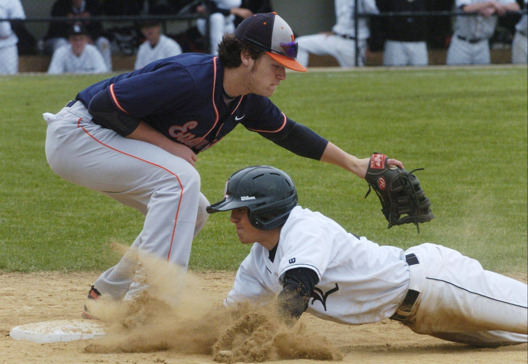 Libertyville's Nick Coutre barely makes it back to first on a pickoff attempt as Evanston's Max Siedlecki applies the tag.