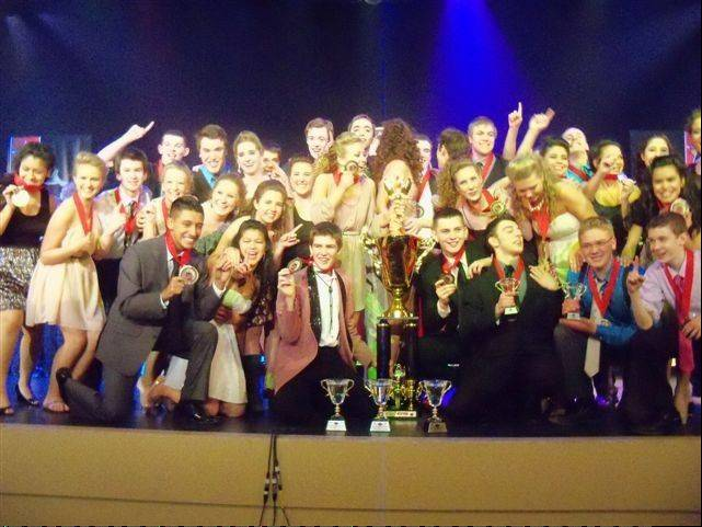 Expressions celebrates its grand championship at the Fame Chicago Competition.
