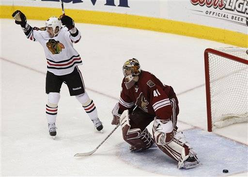Hawks even series with 4-3 OT win over Coyotes