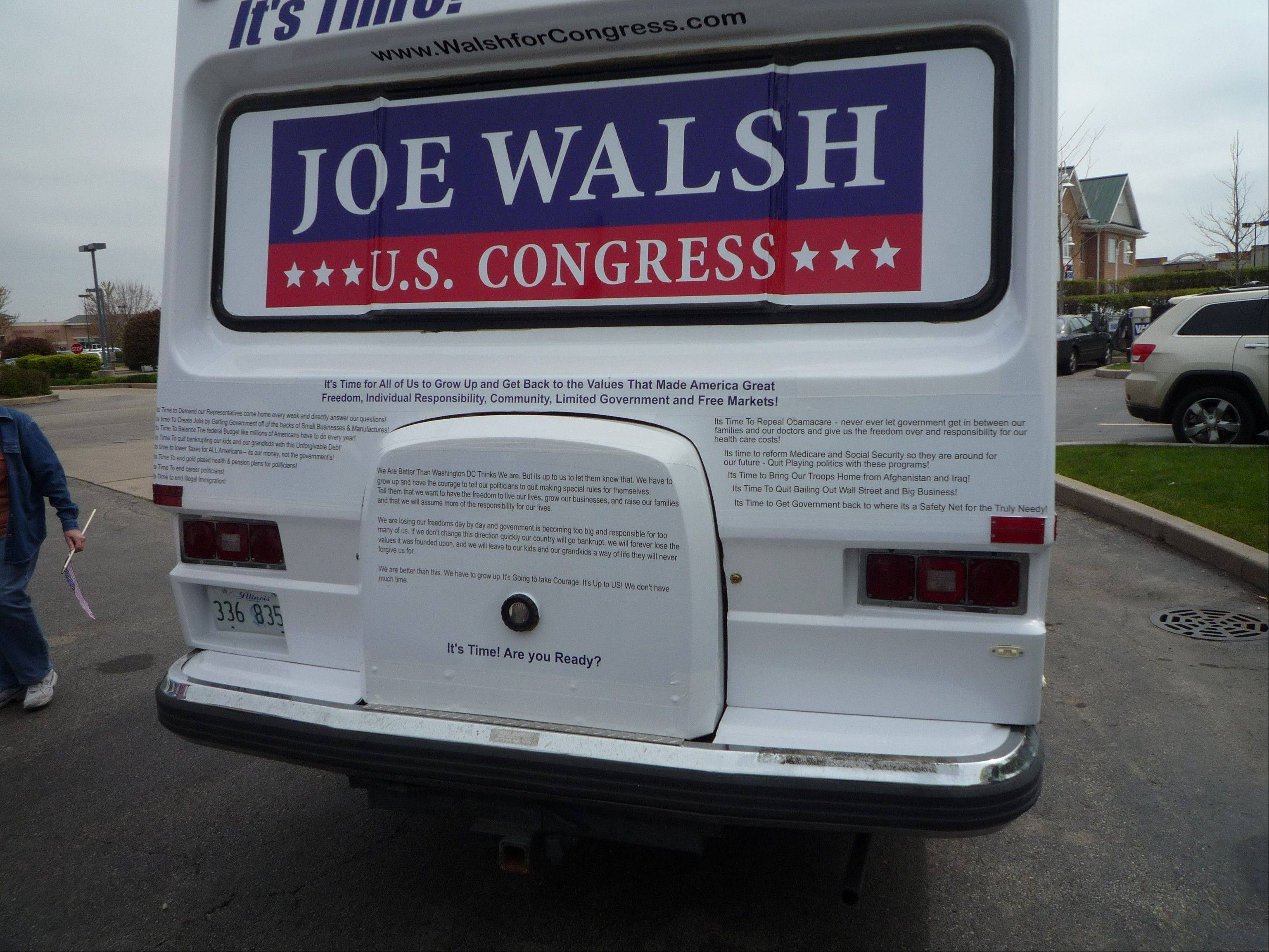 Many of the beliefs of Congressman Joe Walsh are printed on the rear of the campaign motorhome the candidate unveiled Saturday at a Huntley Tea Party rally.