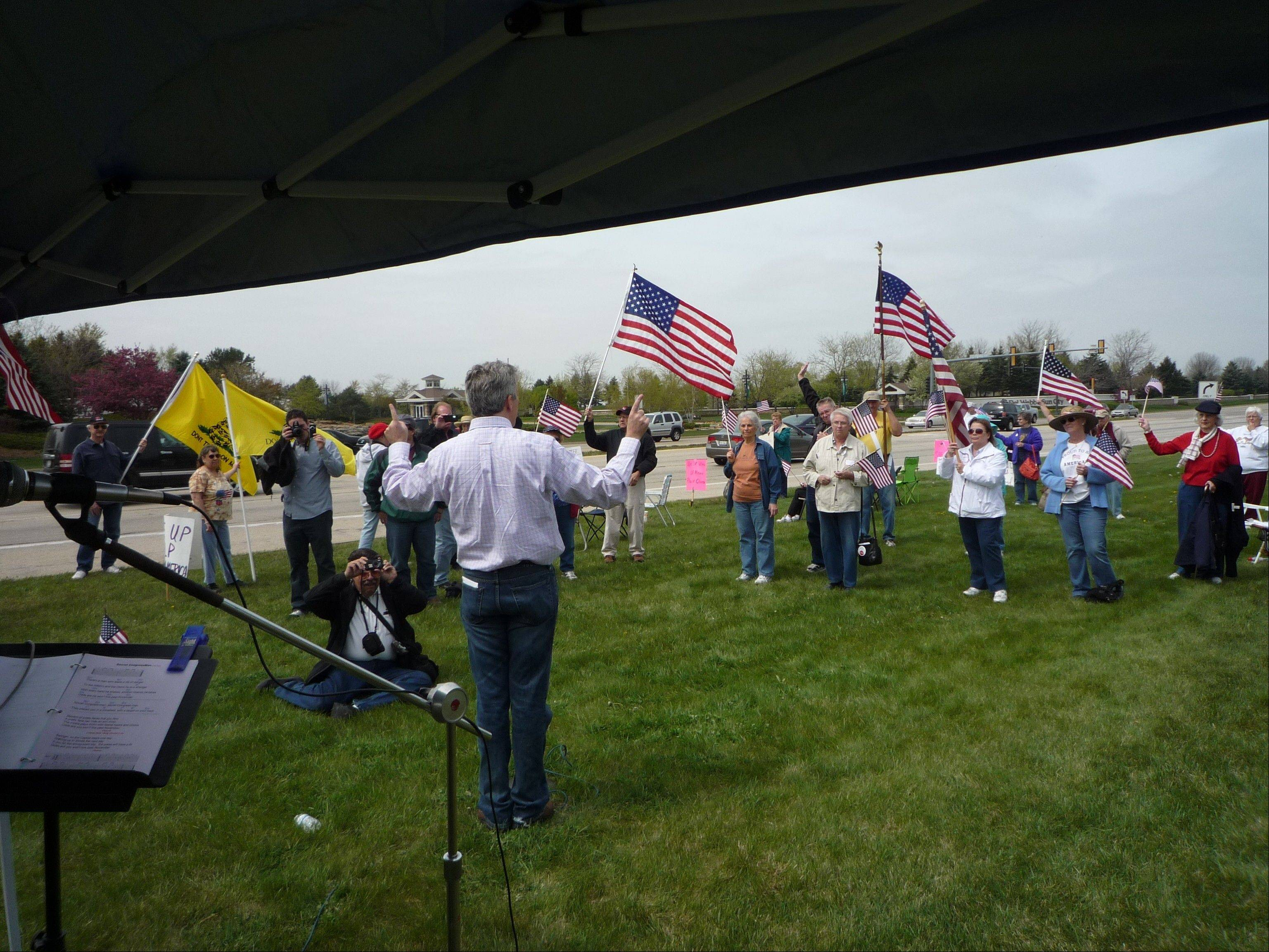 Congressman Joe Walsh welcomes a group of loyal Tea Party supporters during a rally Saturday in Huntley.