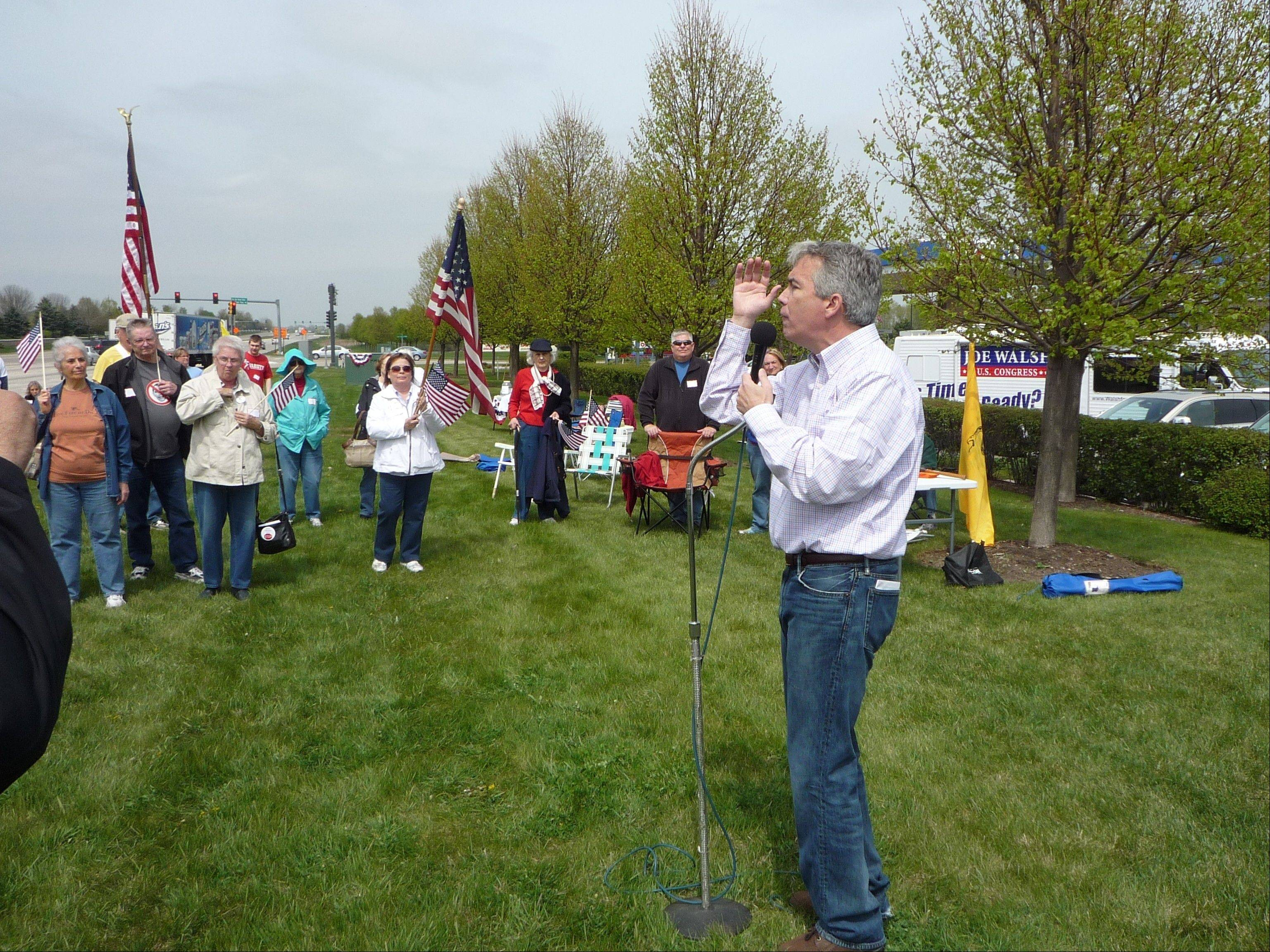 Congressman Joe Walsh speaks to a group of supporters at a rally Saturday in Huntley.
