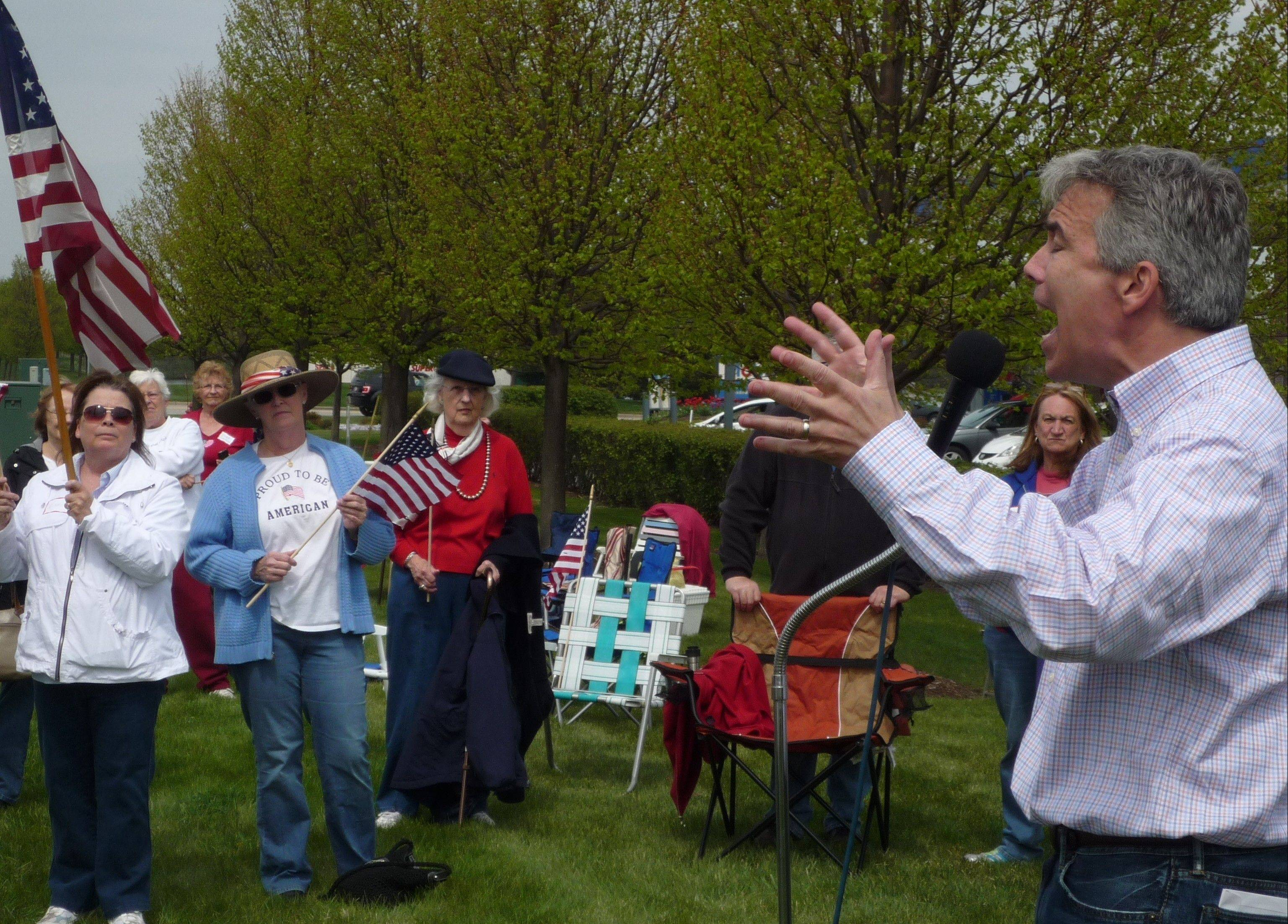 His voice straining at times, Congressman Joe Walsh shouts out his campaign message to a group of loyal Tea Party supporters during a rally Saturday in Huntley.