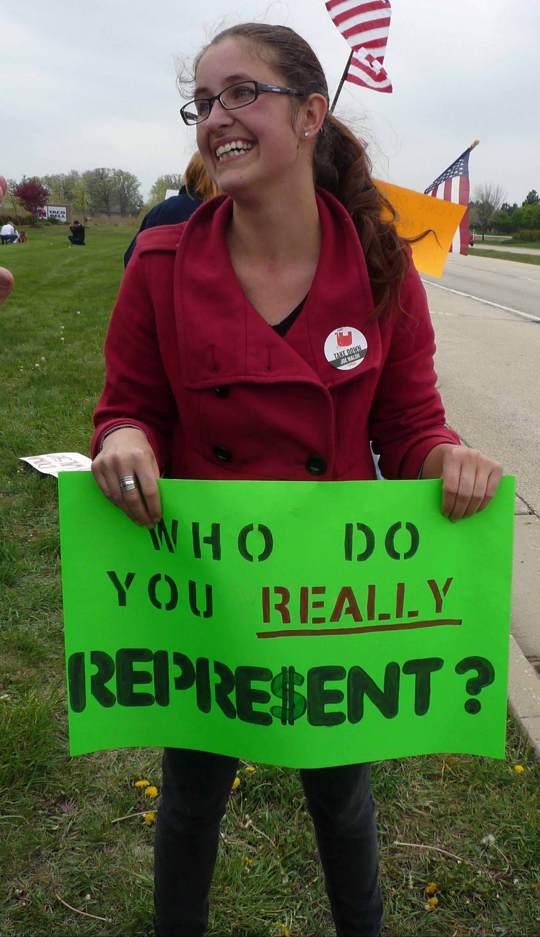 As a district director for a new political action committee out to defeat Tea Party candidates, Kyran McCann of Schaumburg protest against Congressman Joe Walsh at a Tea Party rally Saturday in Huntley.
