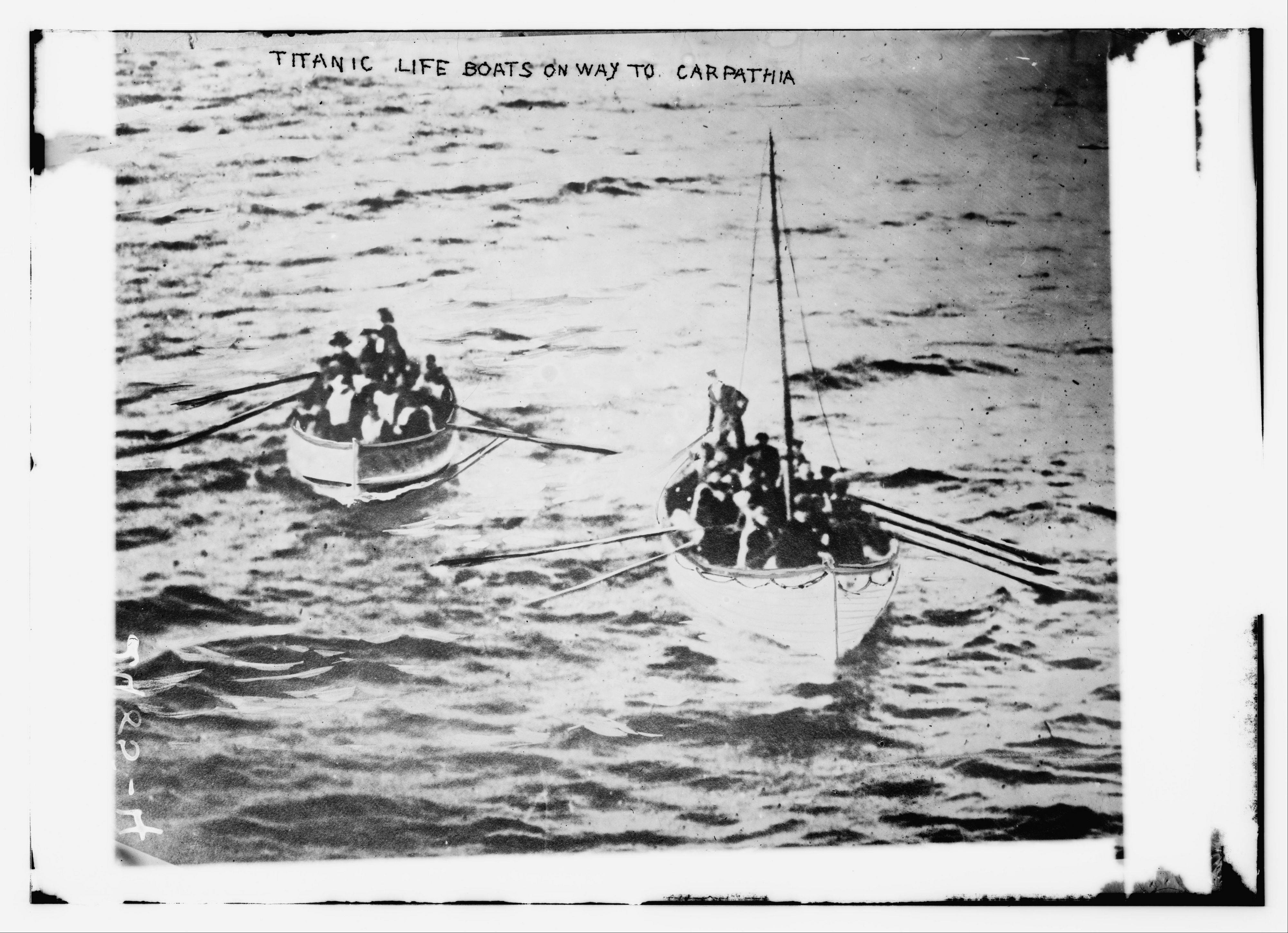 Lifeboat number 14, right, tows collapsible D toward the Carpathia in the early morning on April 15, 1912.