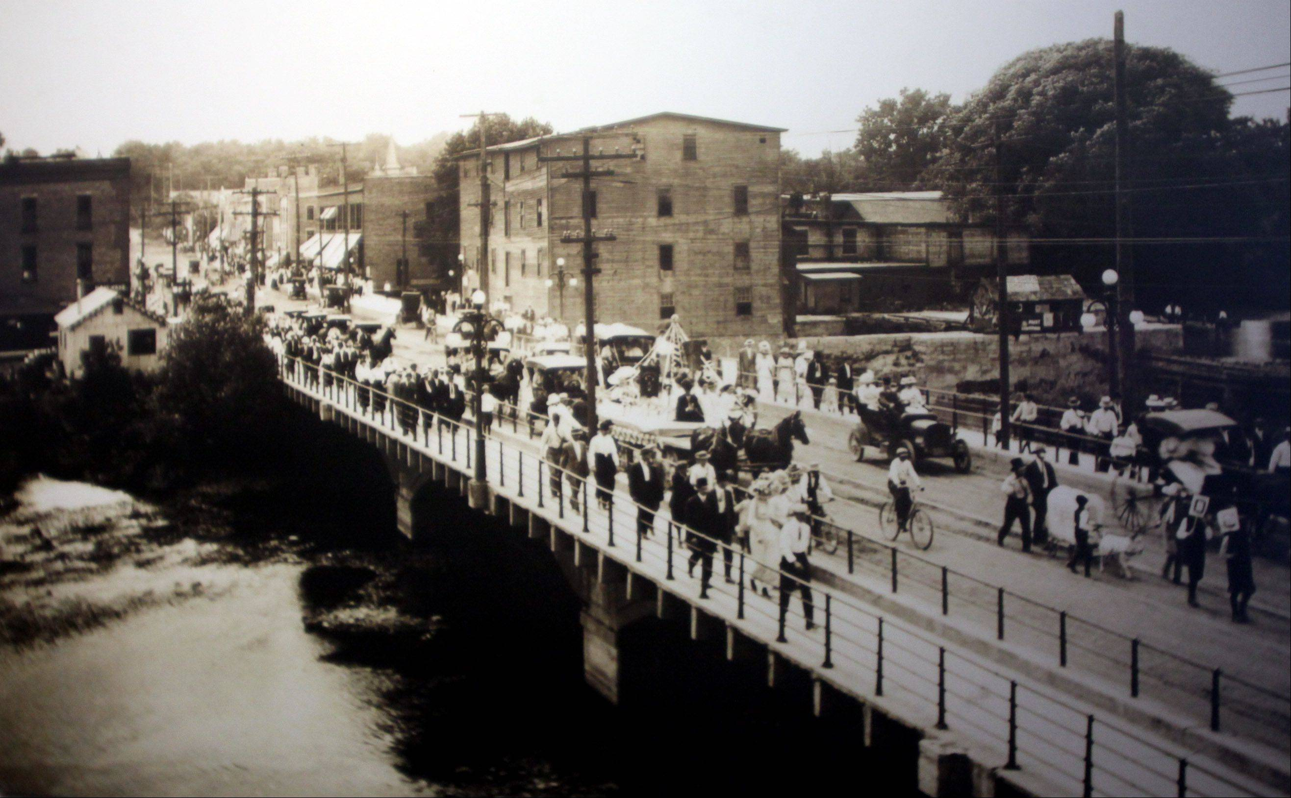 Main Street in St. Charles is pictured in this 1910 image. The Fox River can be seen in the foreground.
