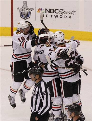 Bryan Bickell, top right, celebrates his game-winning goal with teammates Patrick Sharp, Niklas Hjalmarsson, Viktor Stalberg and Dave Bolland during overtime in Game 2 on Saturday.