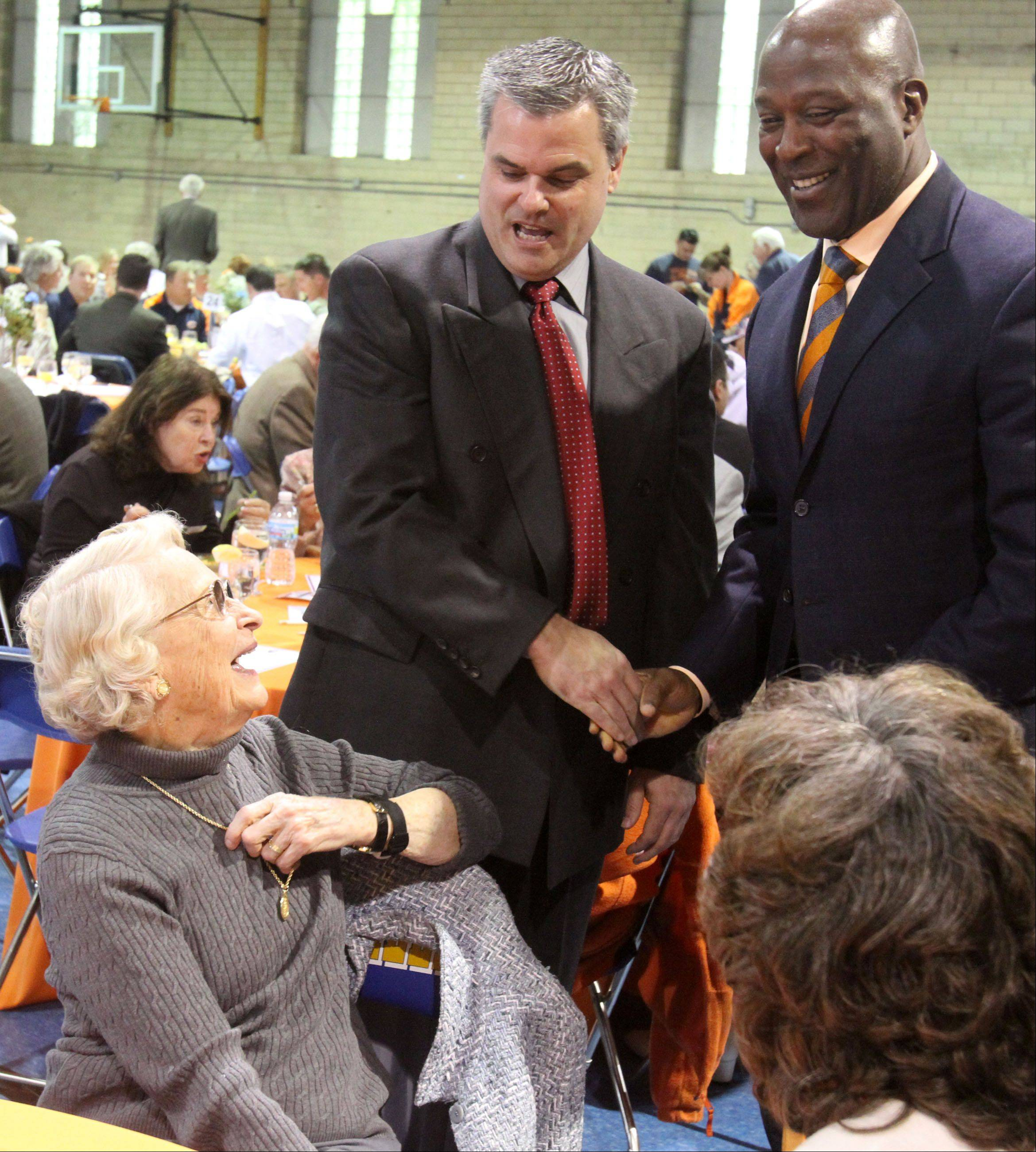 Virginia Halas McCaskey has a laugh with Des Plaines Police Chief Mike Kozak, left, and Bears Coach Lovie Smith at the Ed McCaskey Scholarship luncheon April 10.