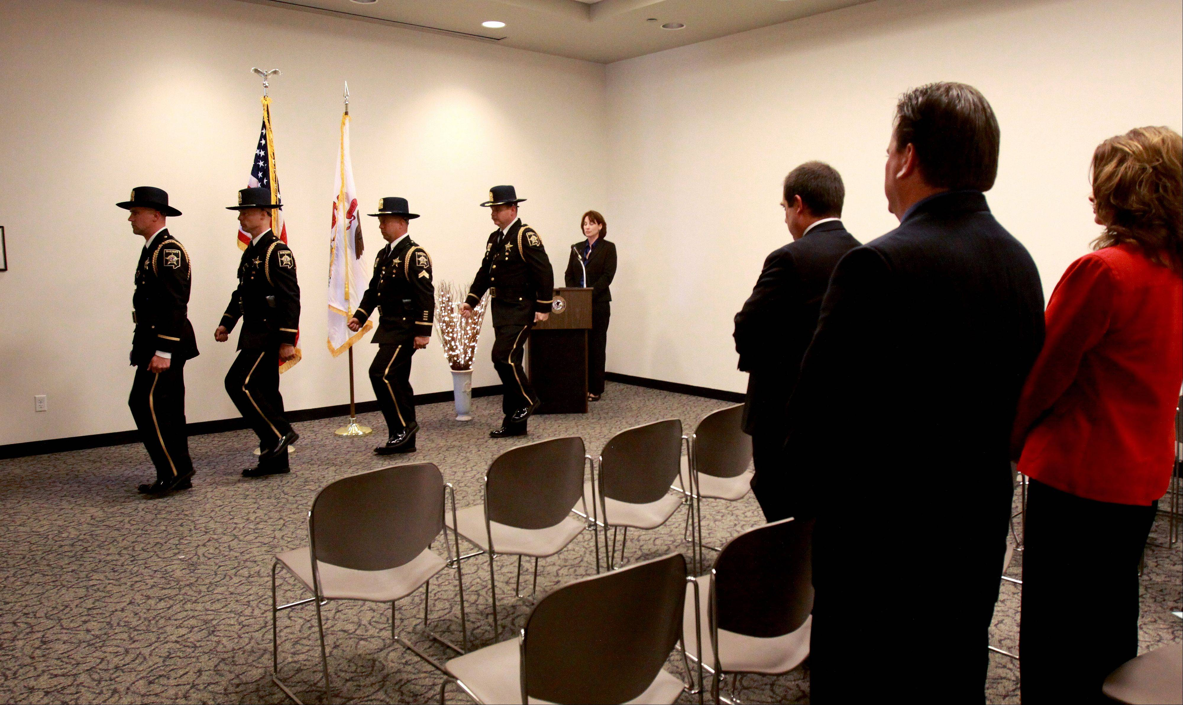 The DuPage County Sheriff's Office Honor Guard takes part in CASA of DuPage County's Hands Around the Courthouse event.