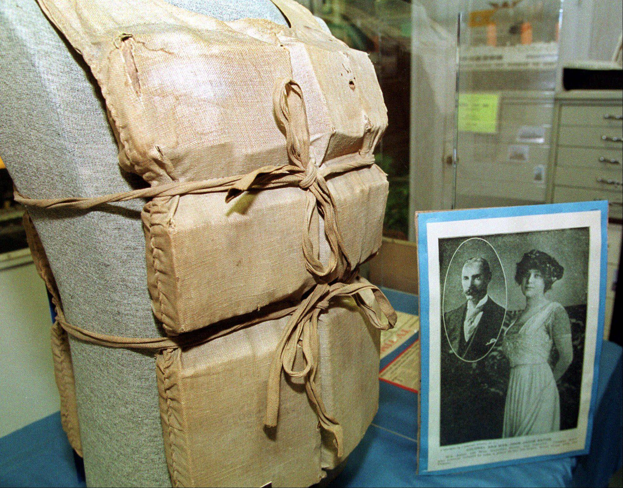 This Titanic life vest -- worn by Madeline Astor, wife of John Jacob Astor IV -- is seen on display at the Titanic Museum in Springfield, Mass. Astor, who was 18 at the time, is shown with her husband, 48 at the time, in the photograph at right. She survived the sinking of the Titanic aboard one of the lifeboats.