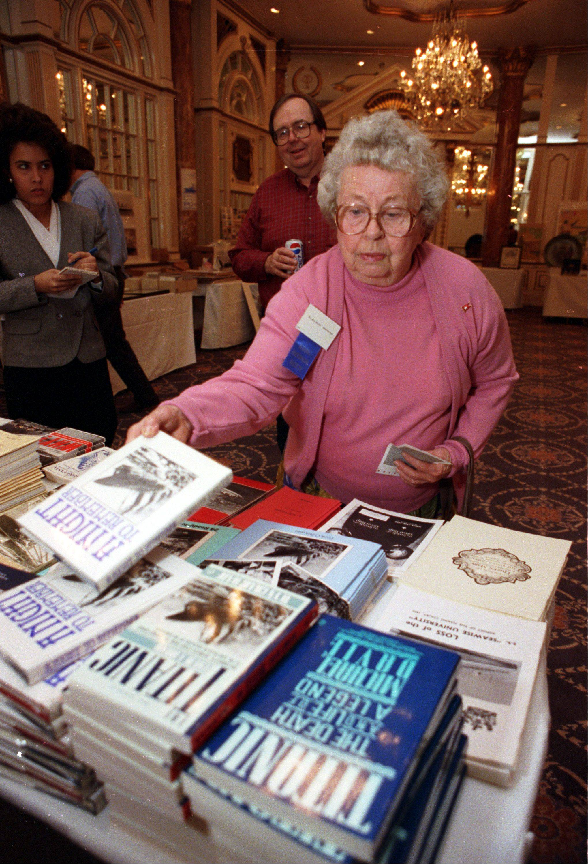 "Eleanor Johnson Shuman, of Elgin, looks over some books about the ""unsinkable"" Titanic while attending a Titanic disaster 80th anniversary gathering in Boston, Mass., on April 10, 1992. Shuman was 18 months old when she survived the disaster with her mother and brother."