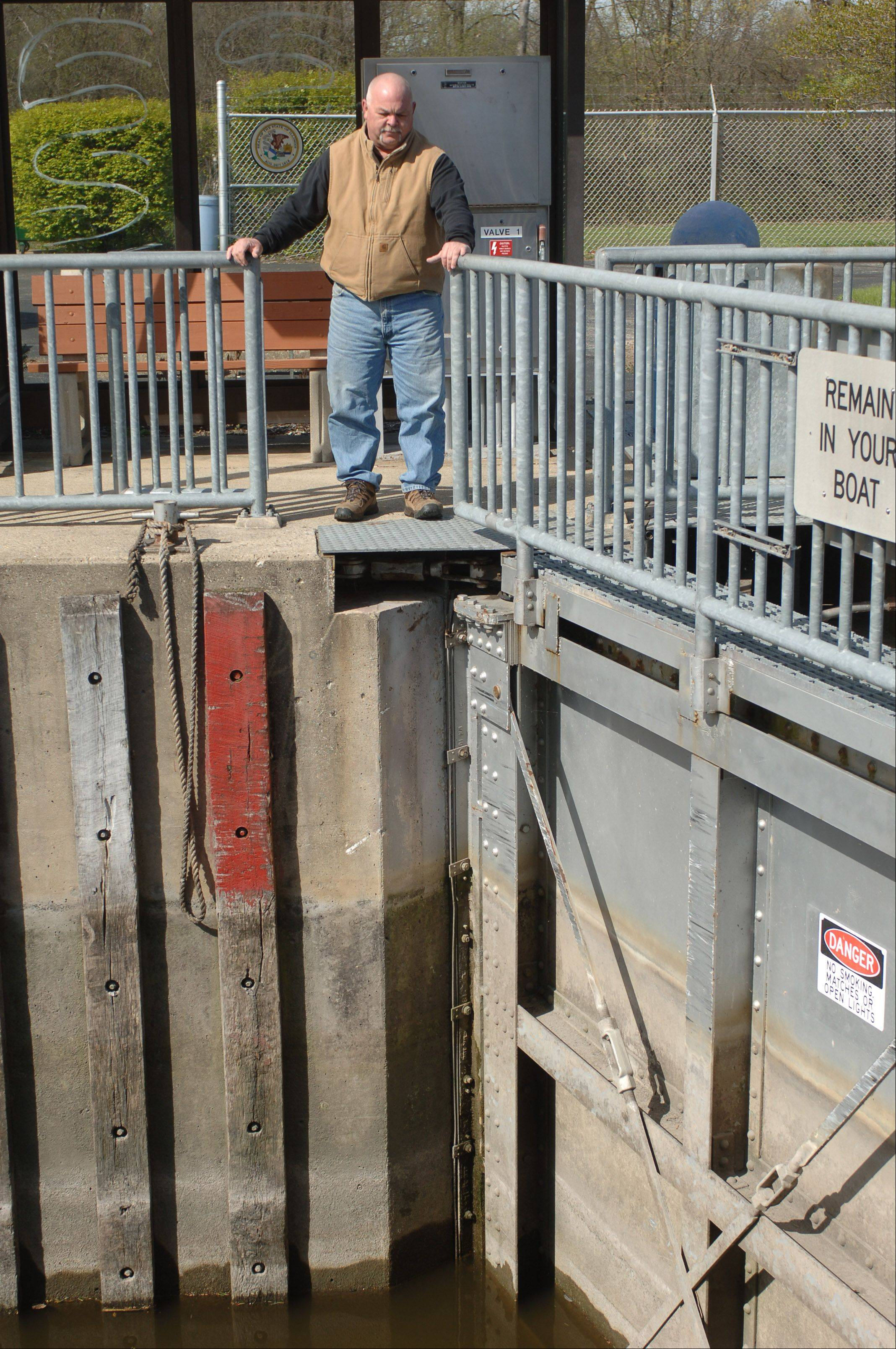 Lockmaster John Palmieri looks over the locks at the William G. Stratton Lock and Dam near McHenry. The Illinois Department of Natural Resources is considering several options for improving the aging structure.