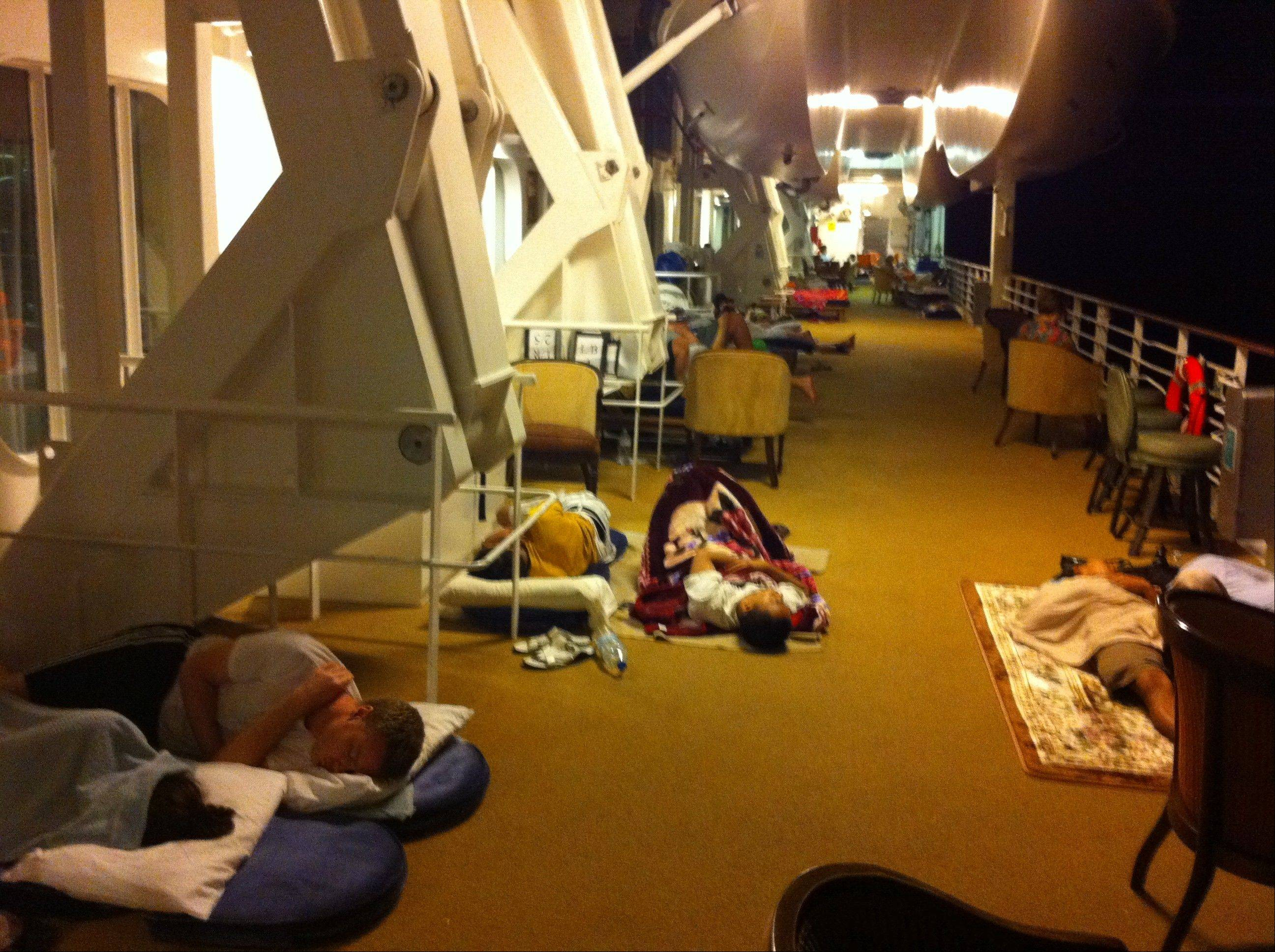 Passengers sleep (or try to) in hot conditions on the deck of the Azamara Quest after an engine fire. Glenview residents Bill and Elizabeth Coulson were aboard the cruise ship last month when the fire set it adrift in the Sulu Sea, near the Philippines, for 24 hours.