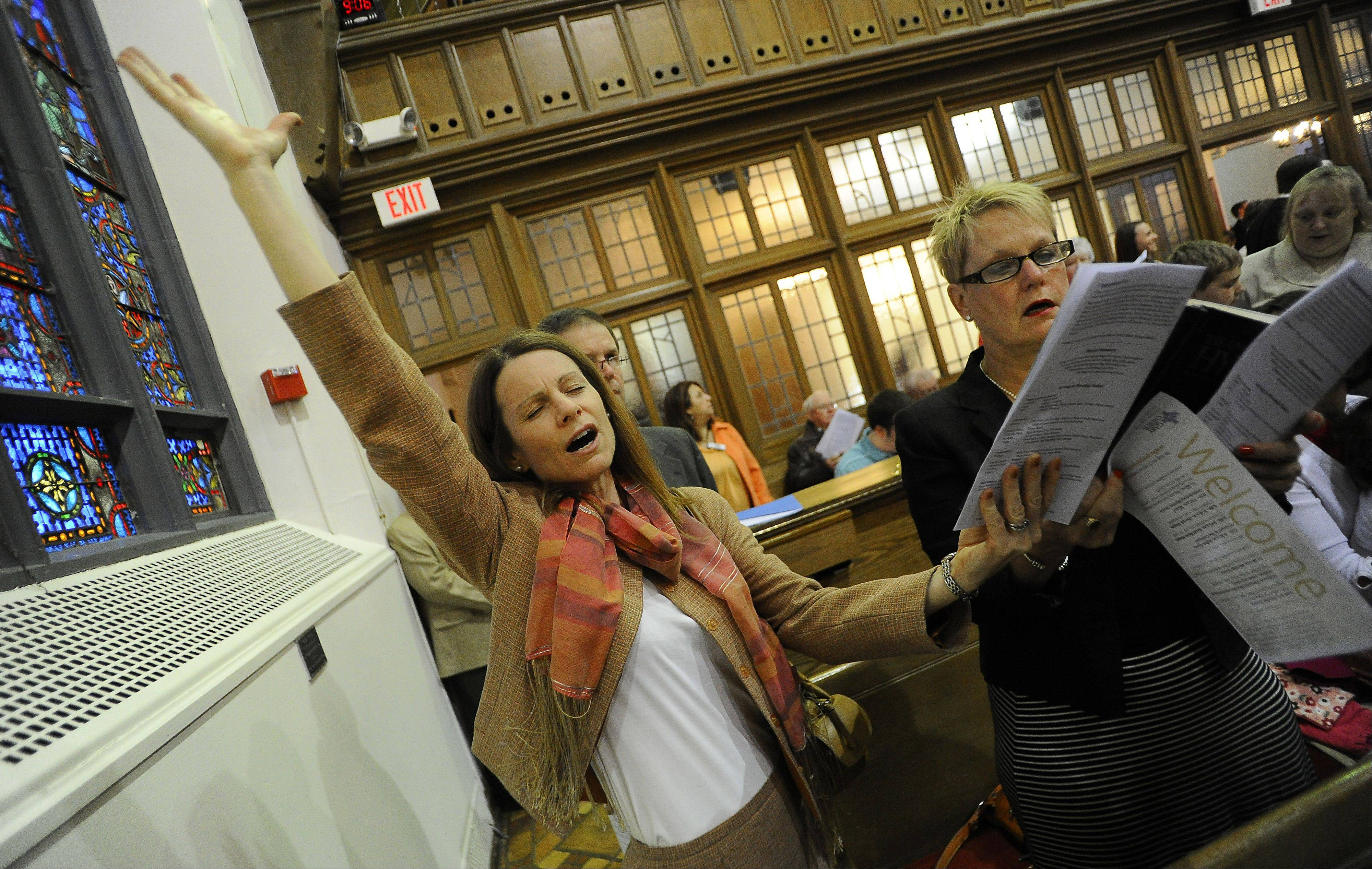 Lynn Cohick of Wheaton feels the power of the Easter service at the Gary United Methodist Church in Wheaton.