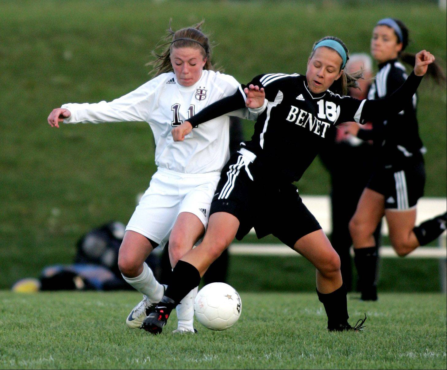 Anne Hillstrom, left, of Wheaton Academy and Katie Liber, right, of Benet get tangled up during girls soccer Monday in West Chicago.