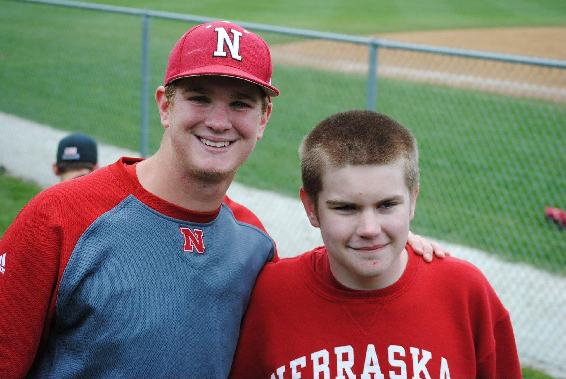 St. Charles North product Zach Hirsch, now pitching for Nebraska, meets up with his former high school lunchmate Graham Jackson during a recent Big Ten game at Northwestern.