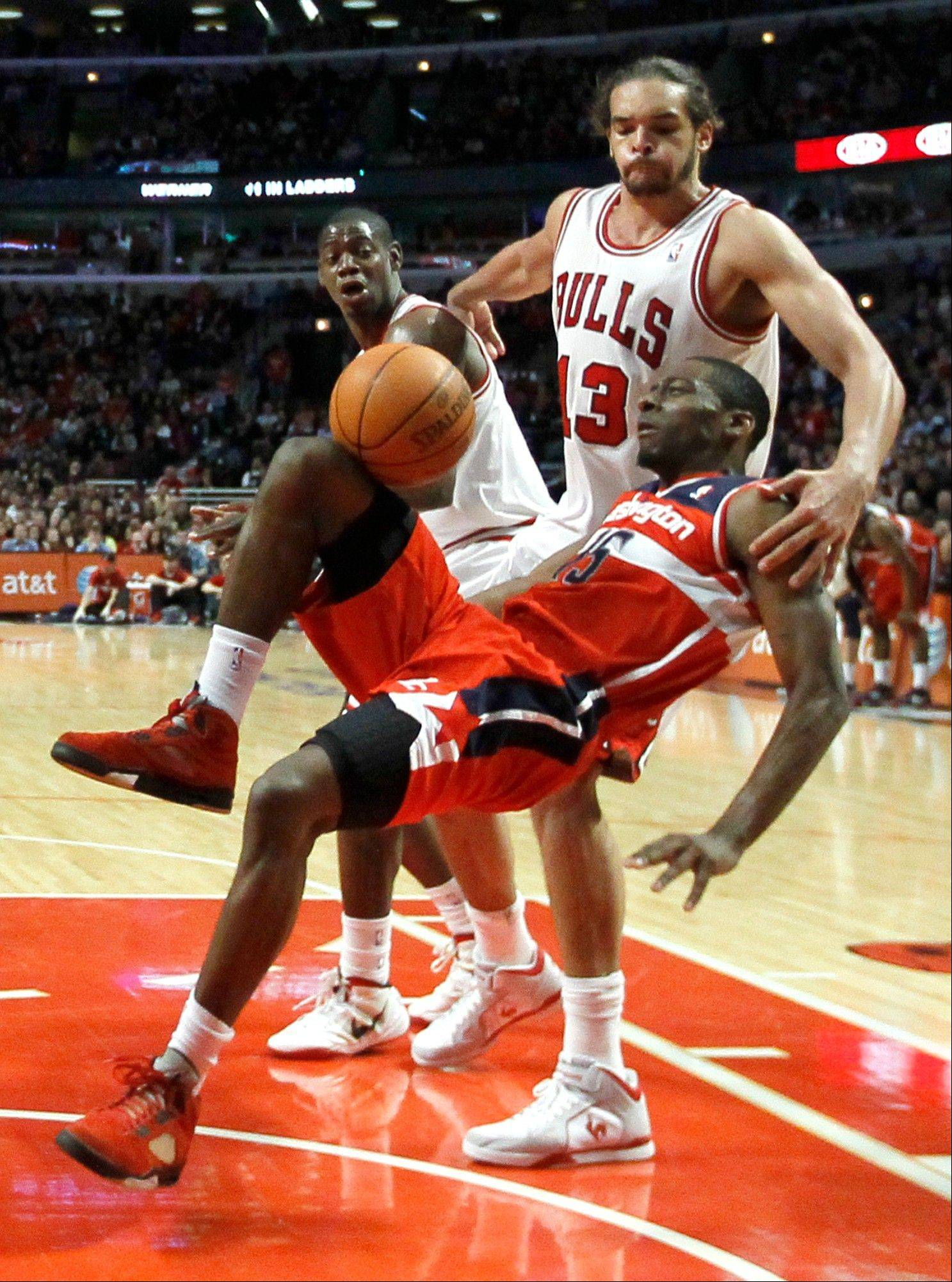 The Wizards' Jordan Crawford loses his footing and the ball after being fouled by Joakim Noah of the Bulls during action at the United Center on Monday night.