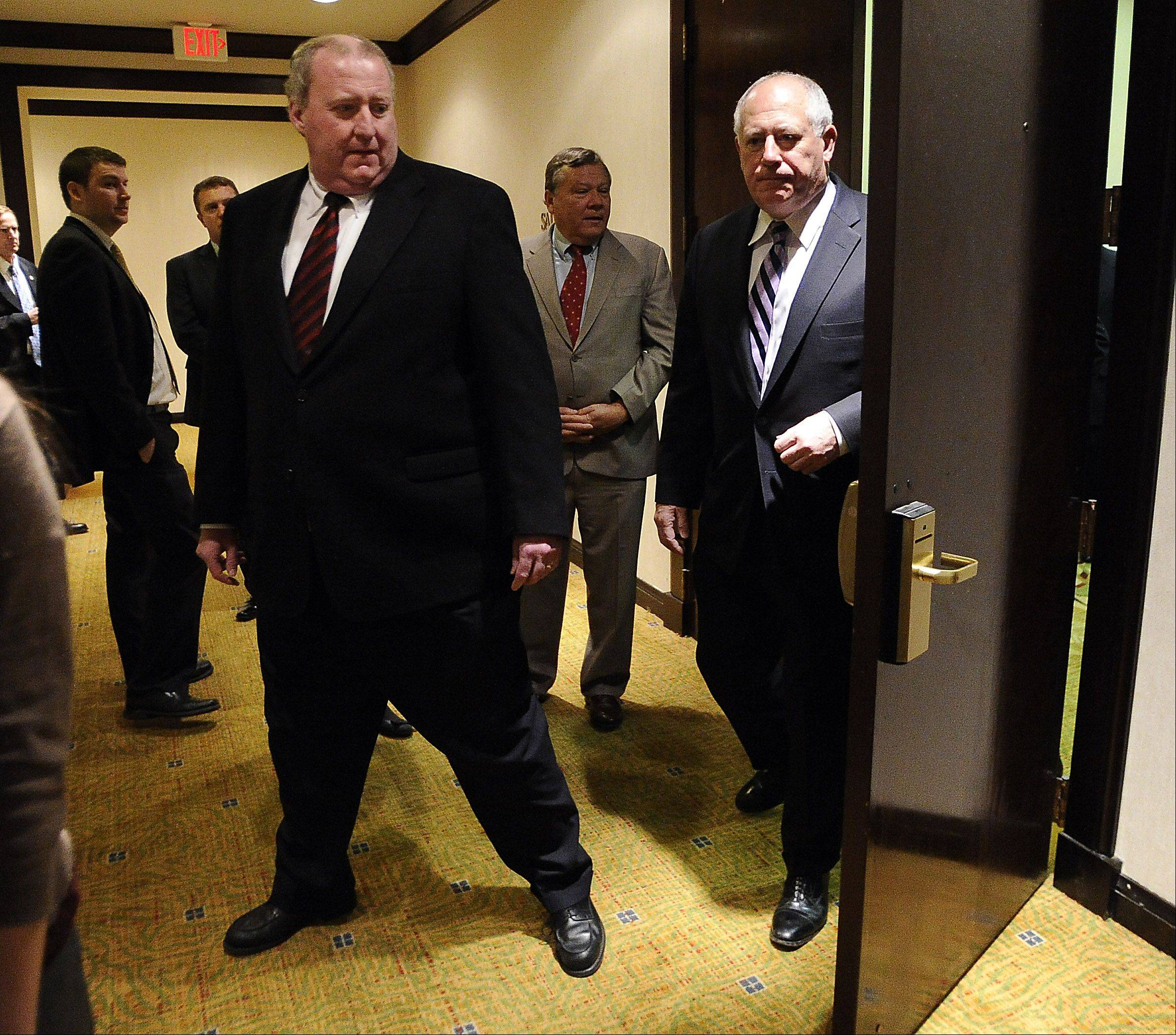 John Stull, CEO of Lafarge North America, left, and Governor Pat Quinn emerge from a private room after talking about the company moving its U.S. headquarters to Illinois.