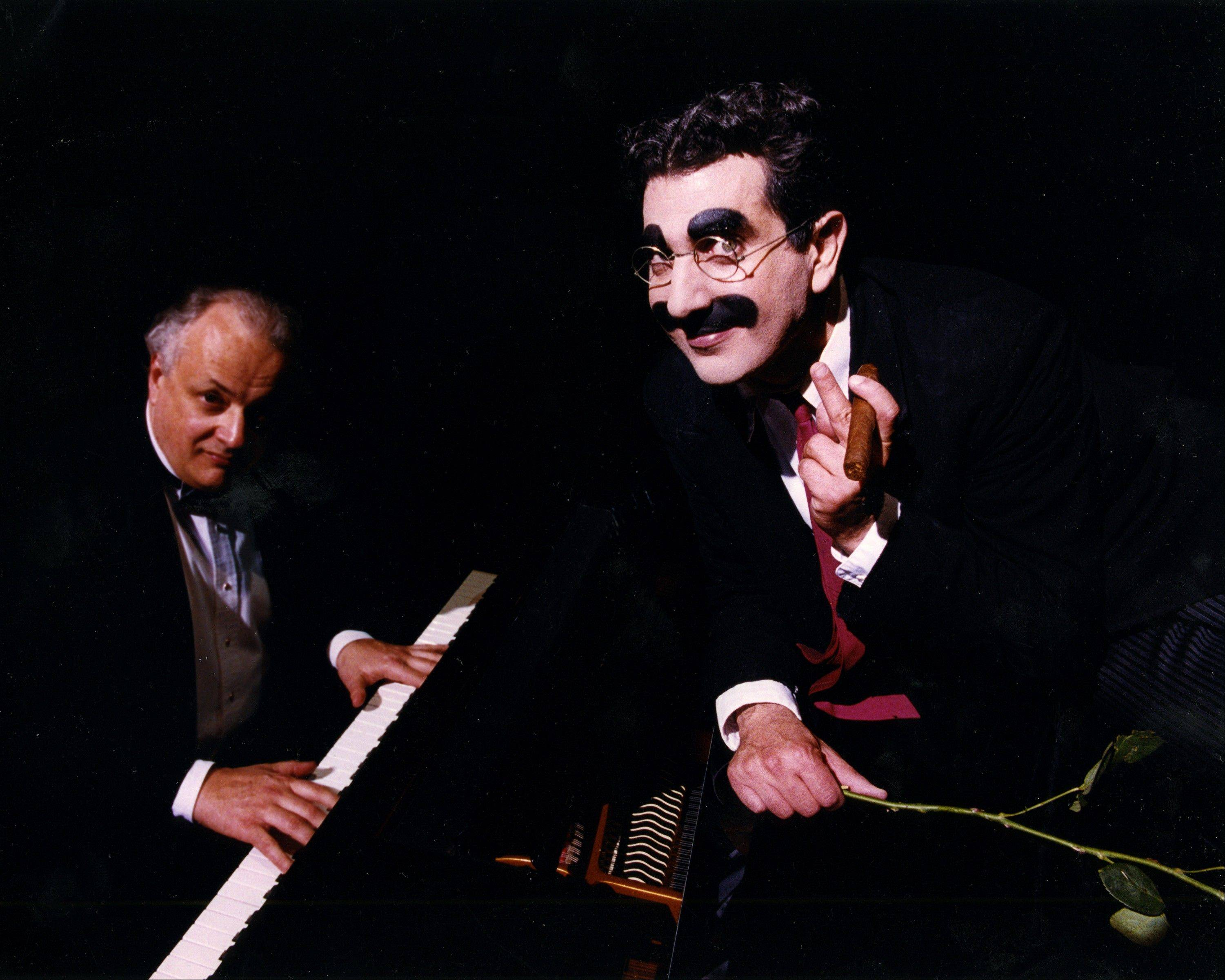 "Frank Ferrante, left, stars as the late comedian Groucho Marx in ""An Evening With Groucho"" on Friday, April 20, at the Paramount Theatre in Aurora."