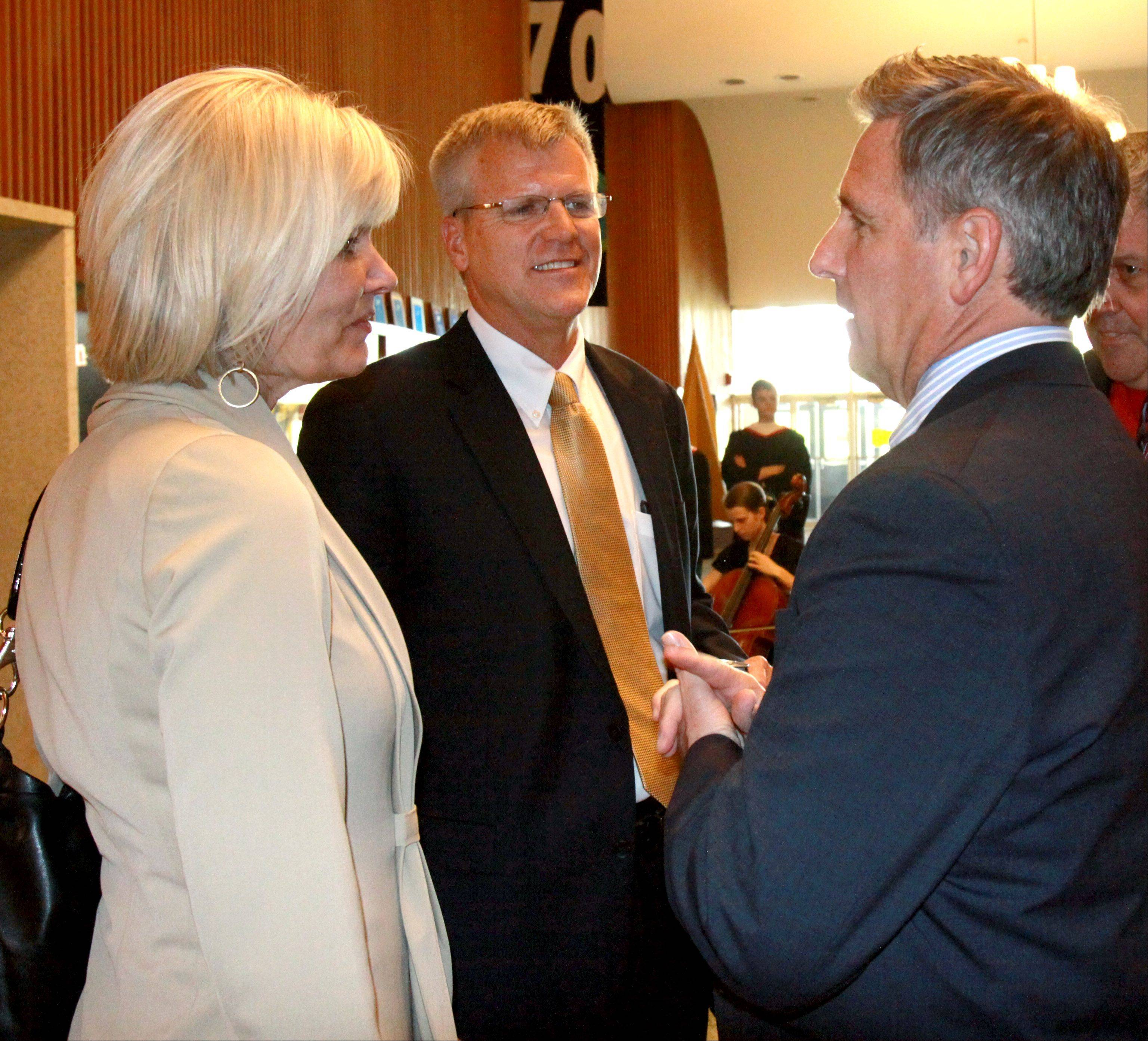 New Glenbard District 87 Superintendent David Larson, center, and his wife Shelayne, chat with Board President Rich Heim at a meet-and-greet reception Monday at Glenbard East in Lombard.