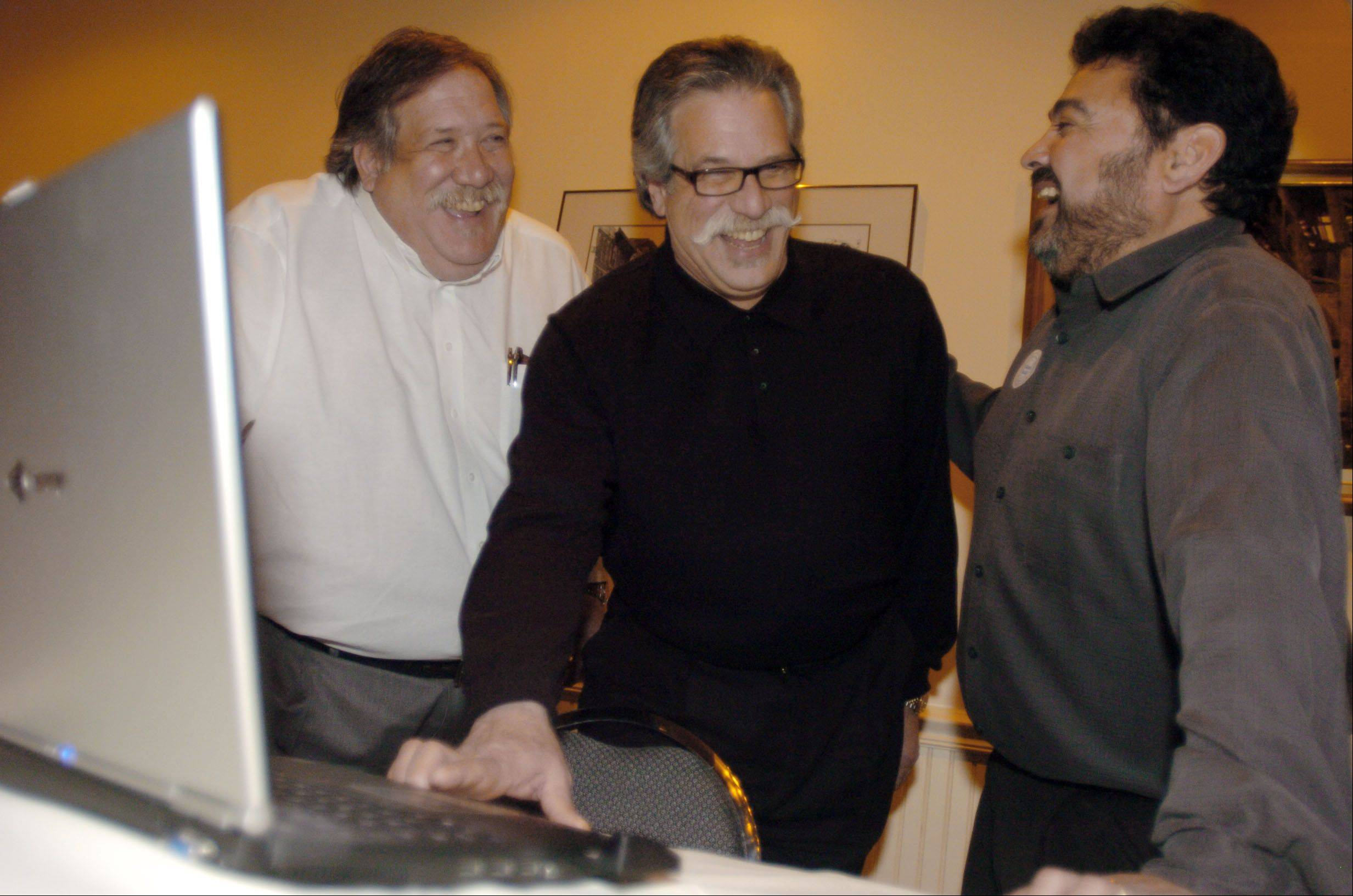 Then-West Chicago mayoral candidate Mike Kwasman, center, was all smiles after winning election in 2007. He was joined by Steve Kwasman, left, and Alderman Ruben Pineda.