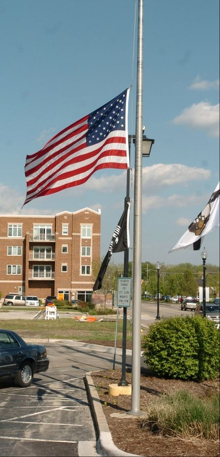 The flag outside West Chicago City Hall was lowered to half mast Tuesday afternoon after the death of Mayor Mike Kwasman.