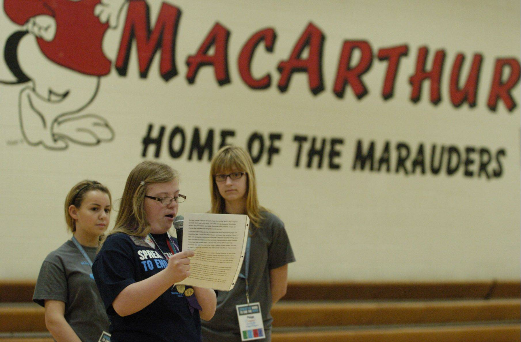 Ela Stoklosa speaks to students at MacArthur Middle School in Prospect Heights. Standing with her at the assembly are Sophia Cacioppo, left, and Paige Palombizio, both seventh-graders from Arlington Heights.