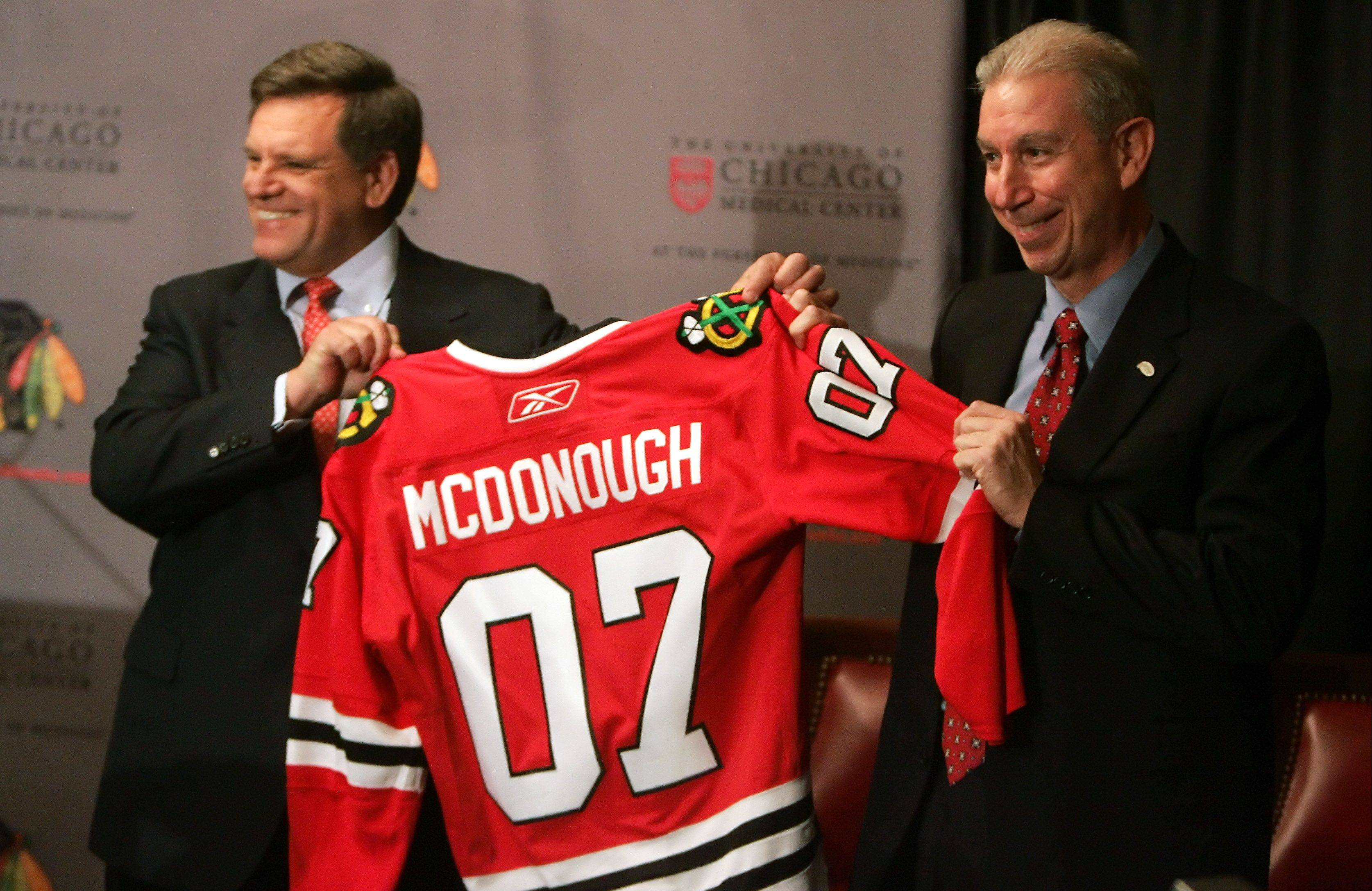Five years after Blackhawks chairman Rocky Wirtz, left, joined forces with John McDonough as team president, the franchise has a Stanley Cup title and four straight playoff appearances.