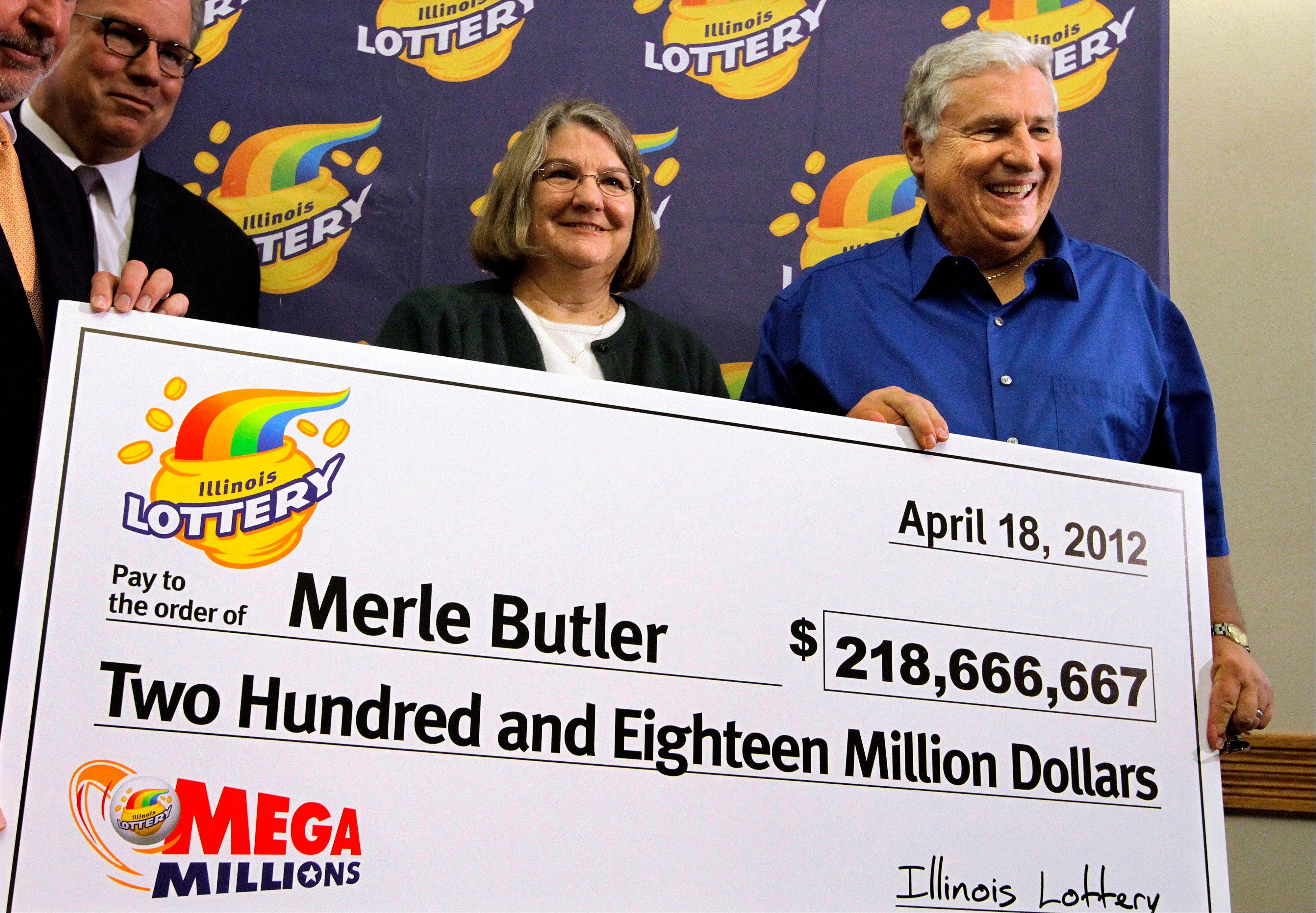 Retired Illinois couple claims share of $656M jackpot