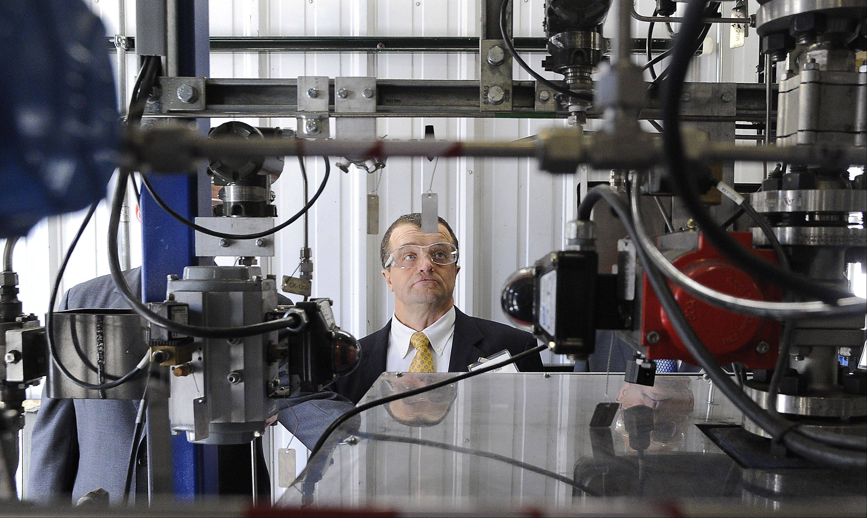 Steven Chalk from the U.S. Department of Energy in Washington D.C. looks over the machinery at Gas Technology Institute (GTI) in Des Plaines.