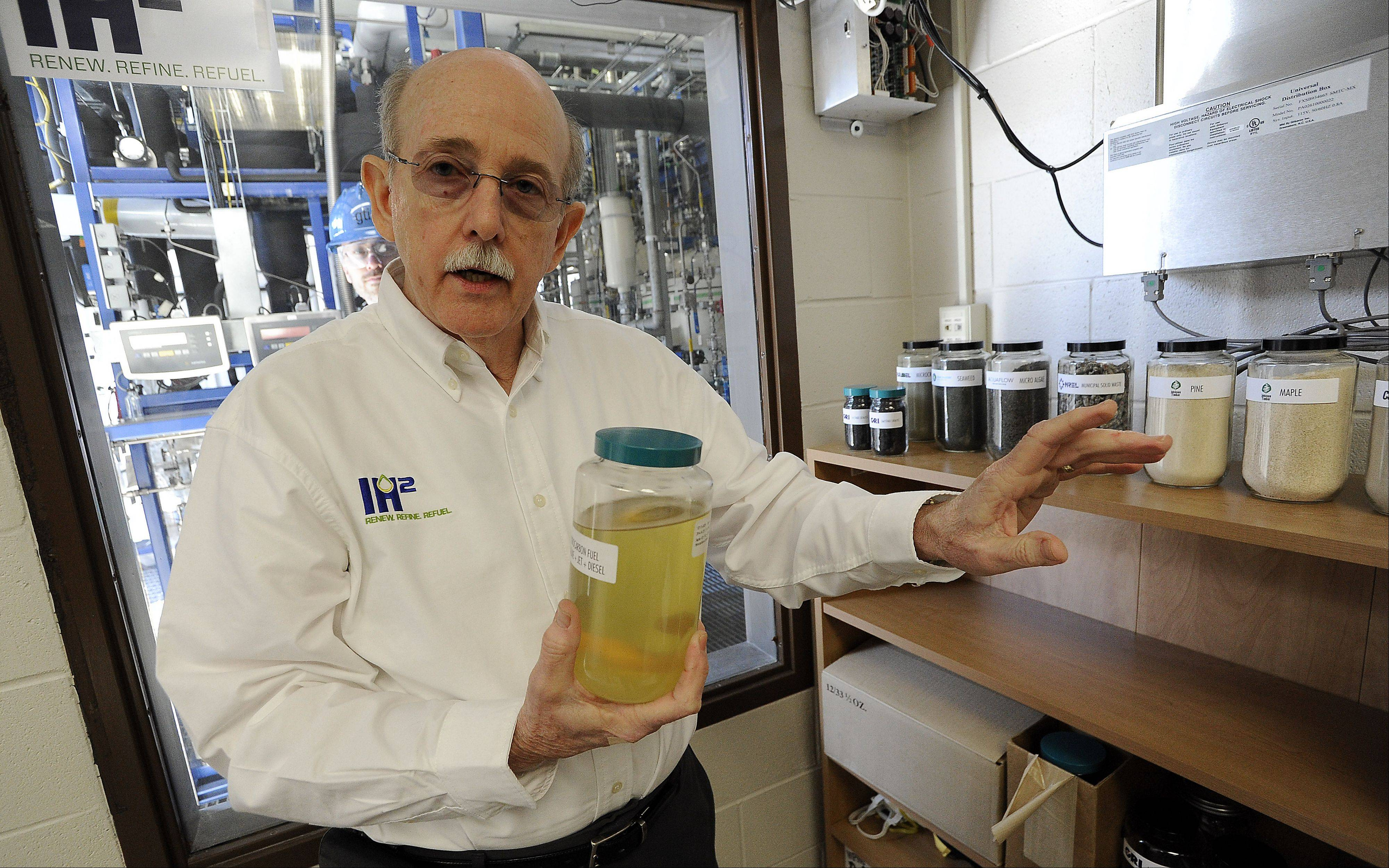 Larry Felix, an engineer and scientist at the Gas Technology Institute in Des Plaines, shows how fuel can be made from corn, algae and other products.
