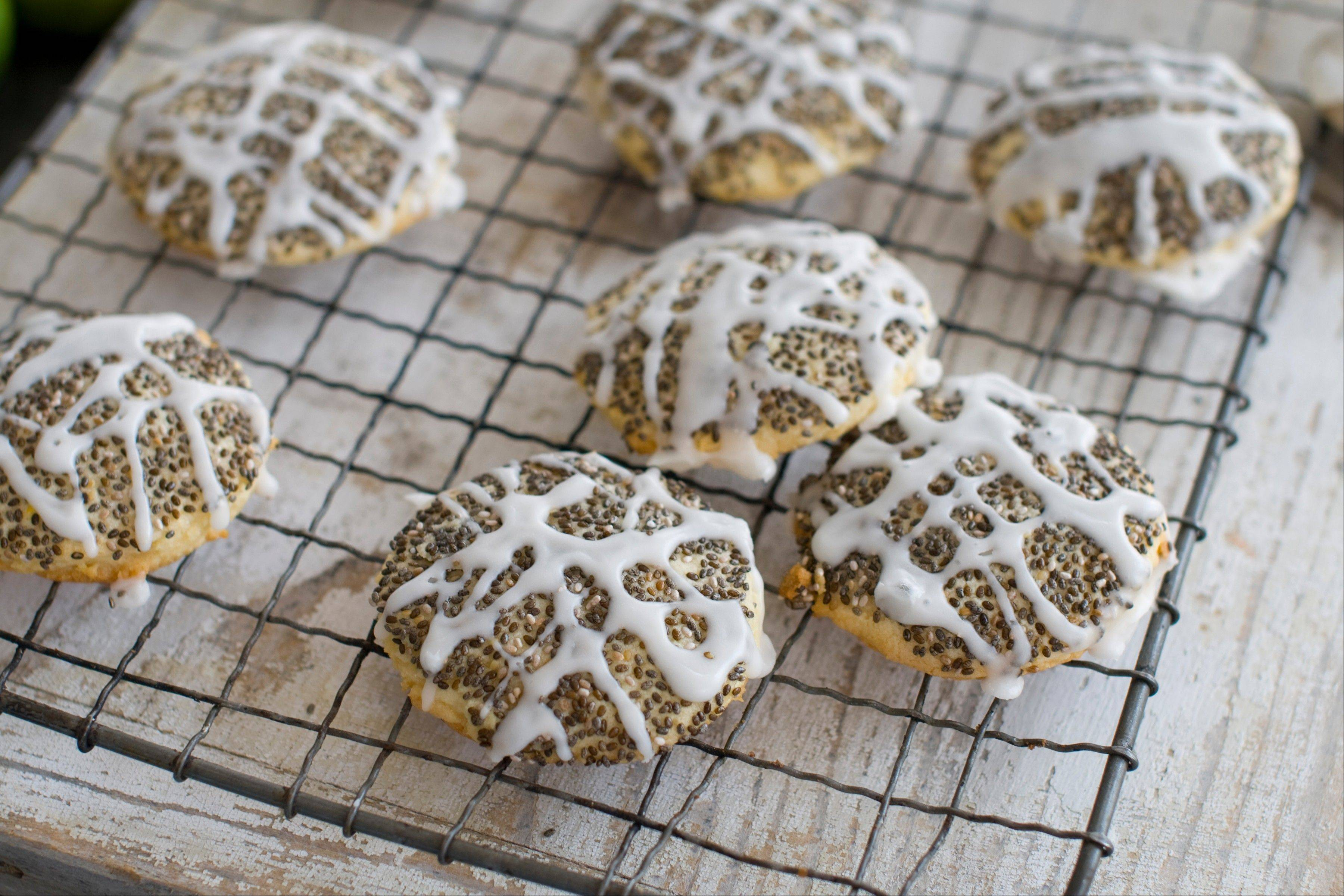 Cookies topped with a lemon glaze and chia seeds show that these tiny seeds are good for more than adorning clay critters.