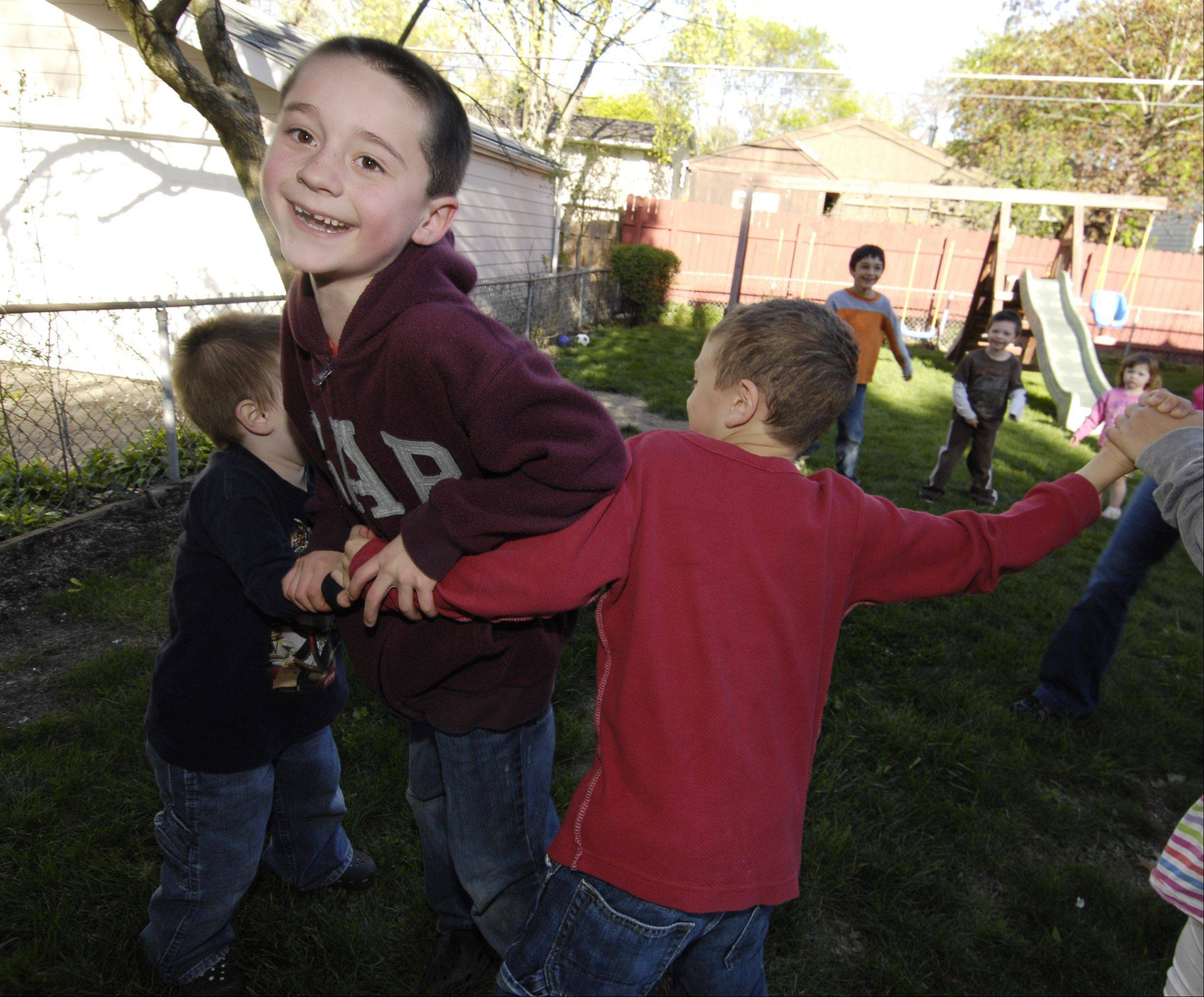 Travis Papievis, 6, tries to break through the line during a game of Red Rover.