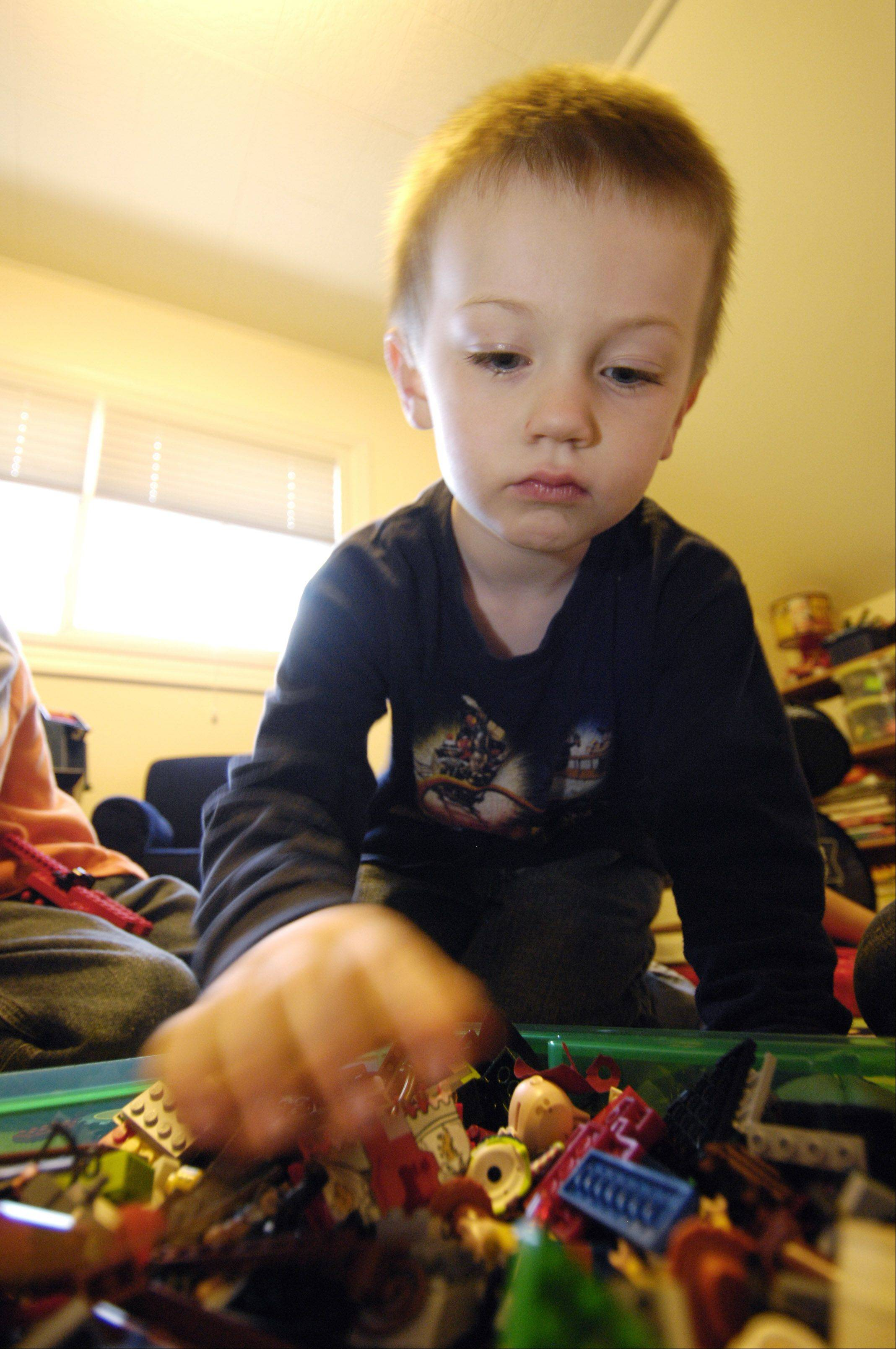 Jeremy Howard, 4, digs for some Legos.