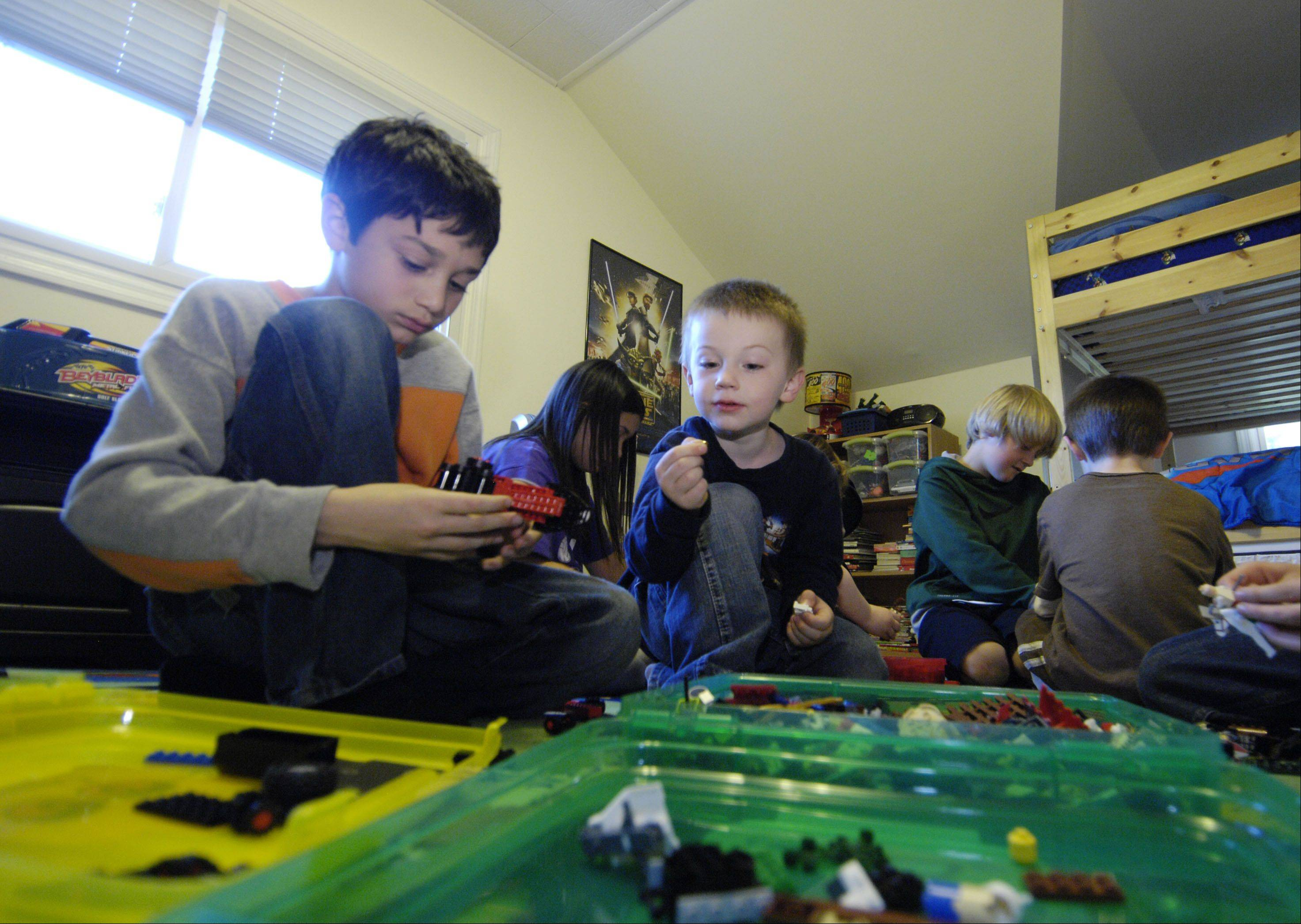 Colin Gavin, 8, and Jeremy Howard, 4, dig for some Legos.