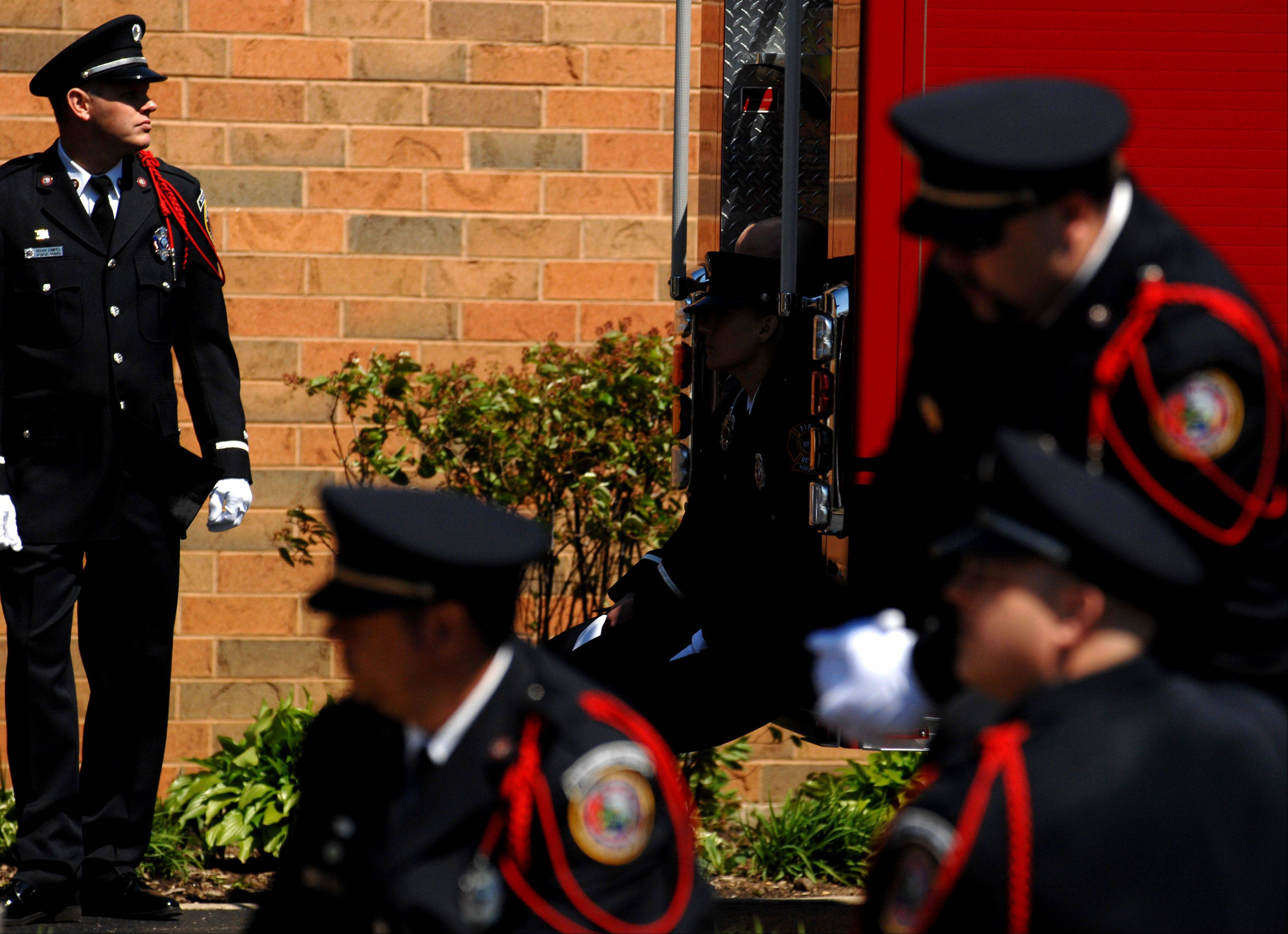 Members of the honor guard wait outside while funeral services go on for Huntley Fire Capt. John Winkelman at St. John's Lutheran Church in Union. Winkelman, 54, of Marengo, was killed in a motorcycle accident last week in Crystal Lake.