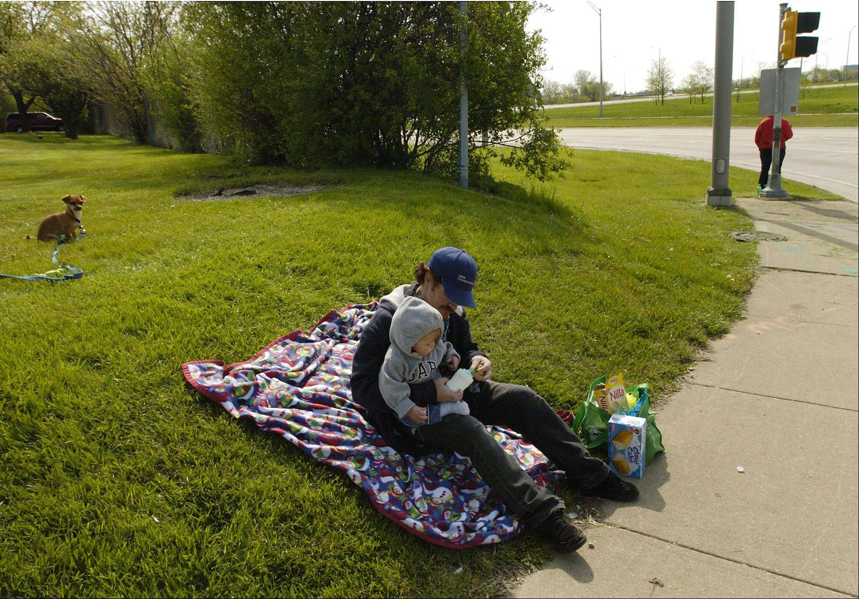 Joey Giancaspro, along with his wife, April, 1-year-old son, Gavin, and pet dog, Chivo, have been squatting on a parkway off the westbound exit ramp of the Jane Addams Tollway and Arlington Heights Road for the past few days to ask for donations.